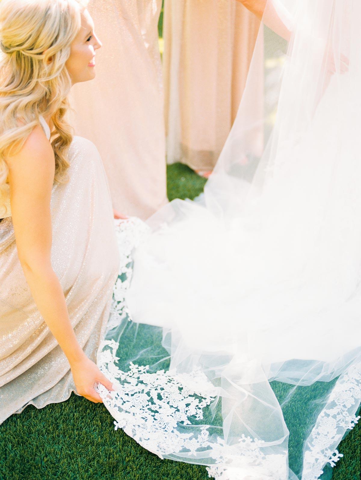 bridesmaid-helping-bride.jpg