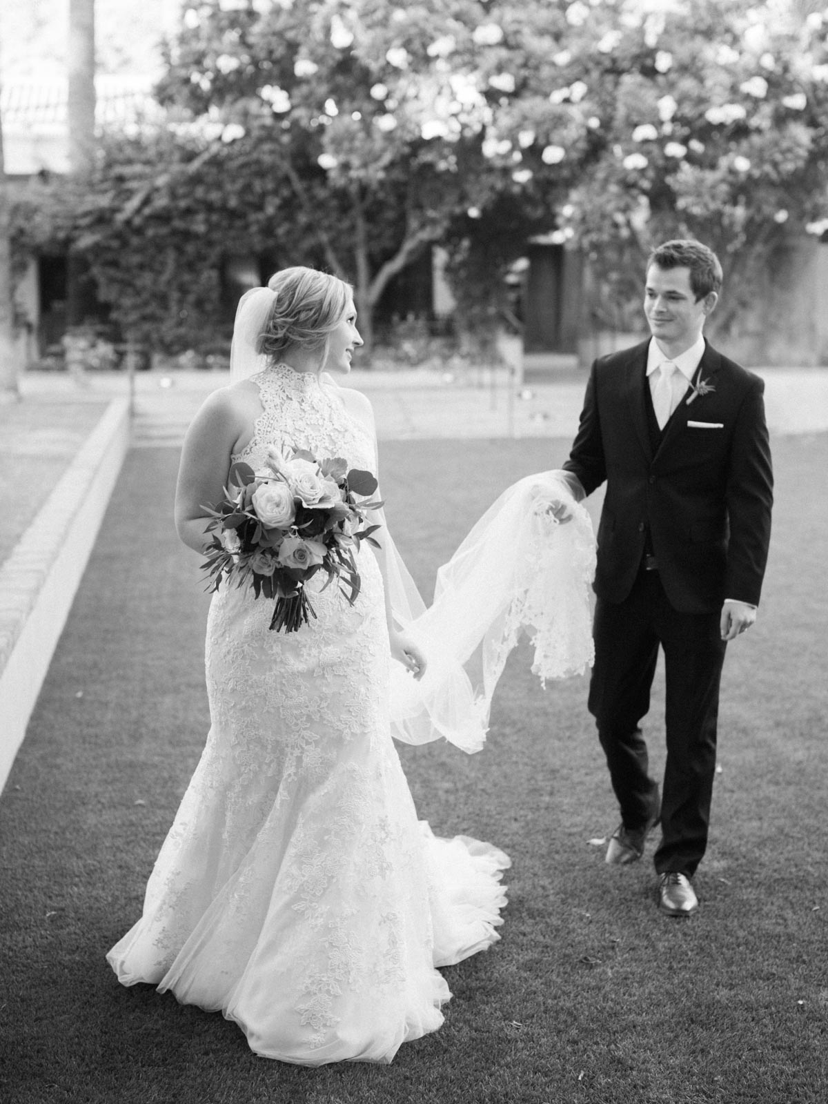 groom-holding-veil.jpg