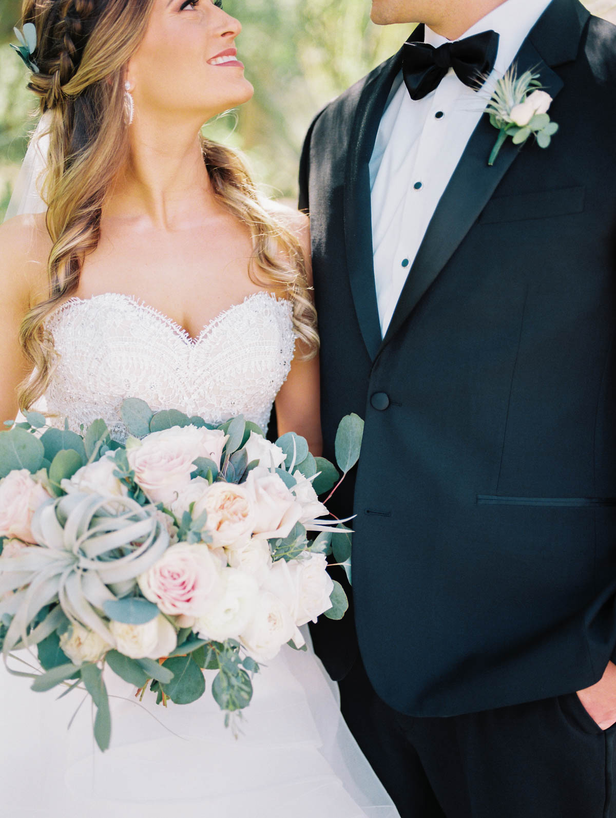 Smiling bride and groom captured by Tucson Wedding Photographers Betsy & John