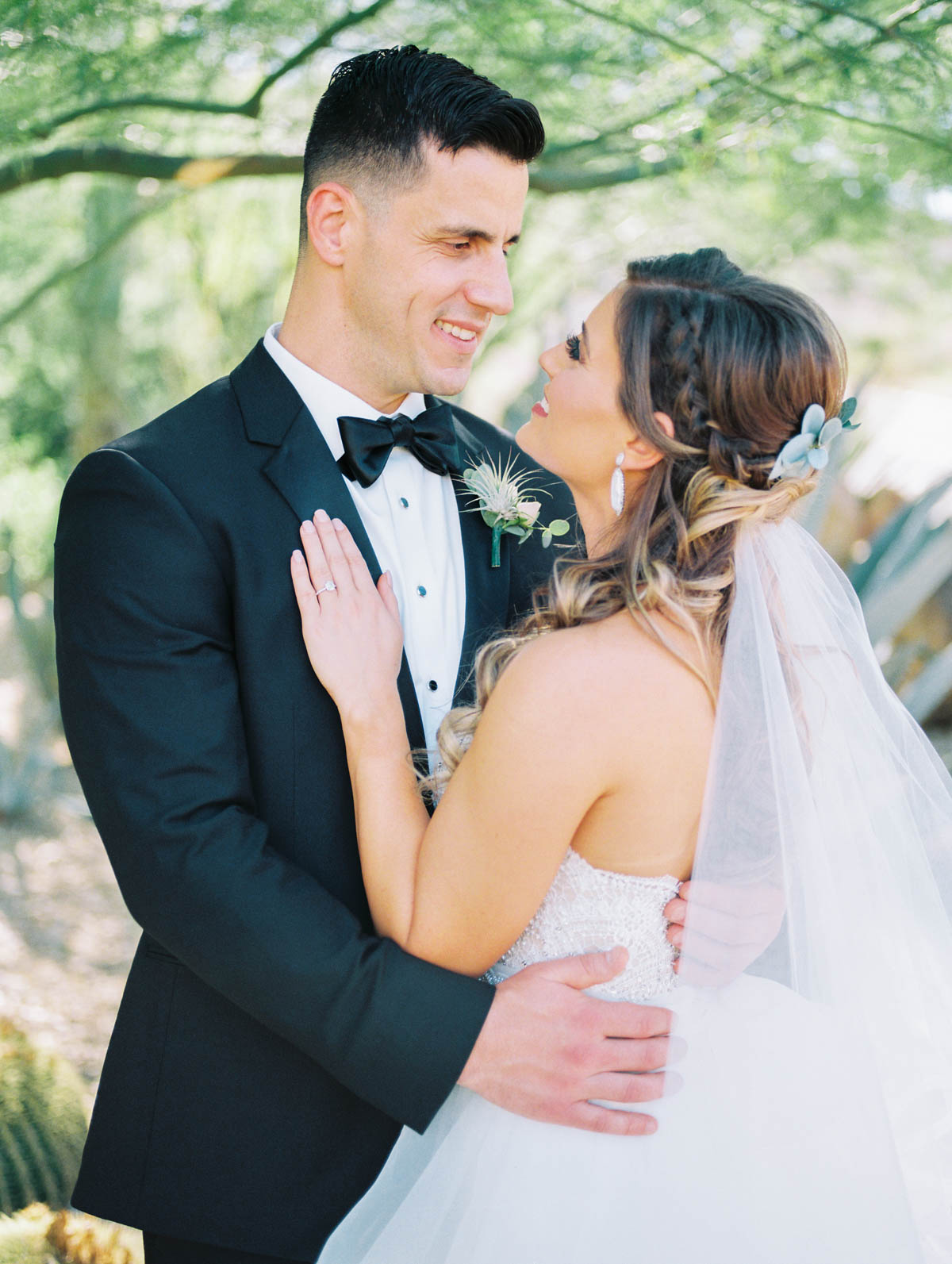 Bride & groom smiling at each other captured by Tucson Wedding Photographers Betsy & John