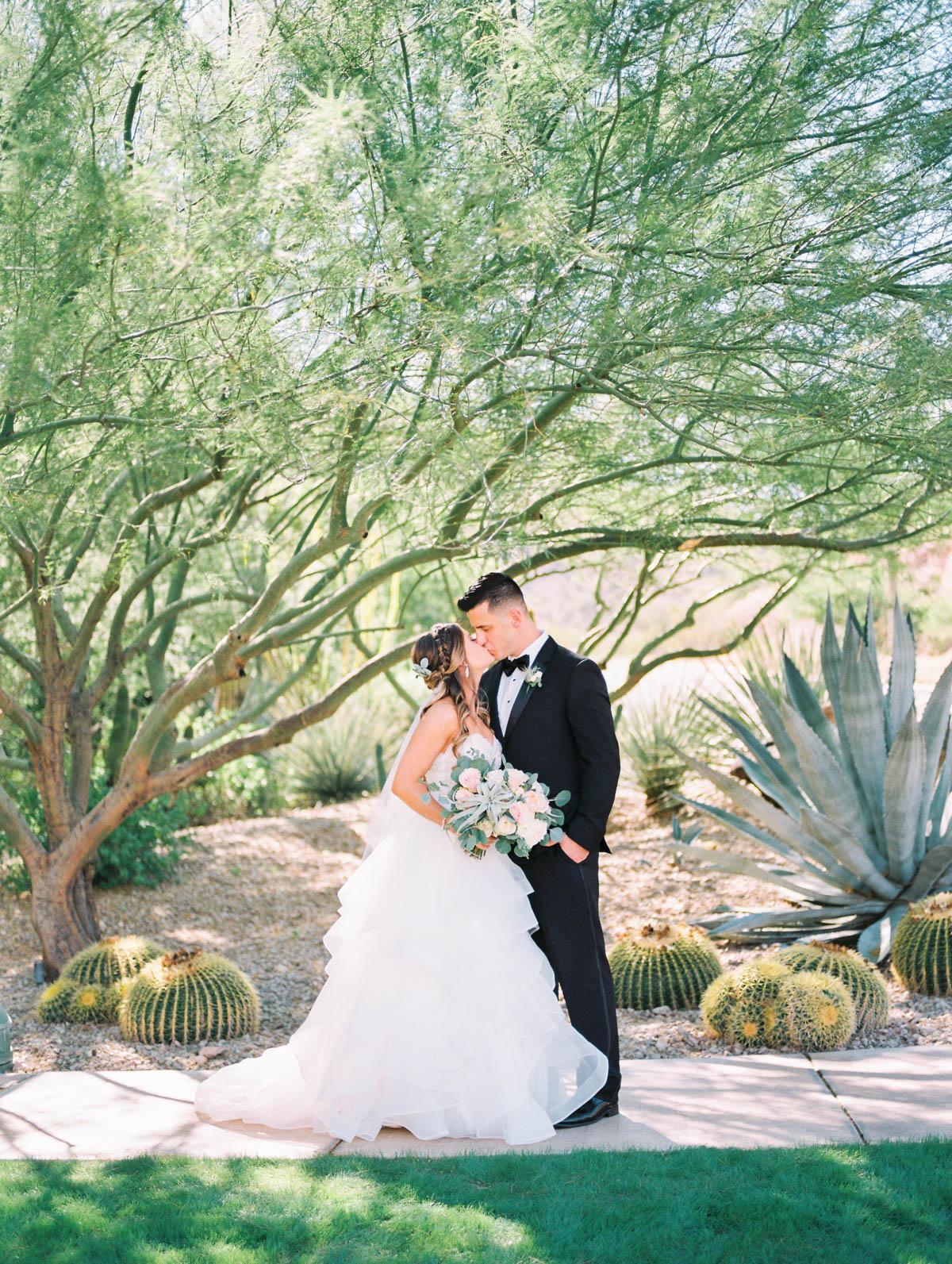 Bride & groom at JW Marriott Starr Pass captured by Tucson Wedding Photographers Betsy & John