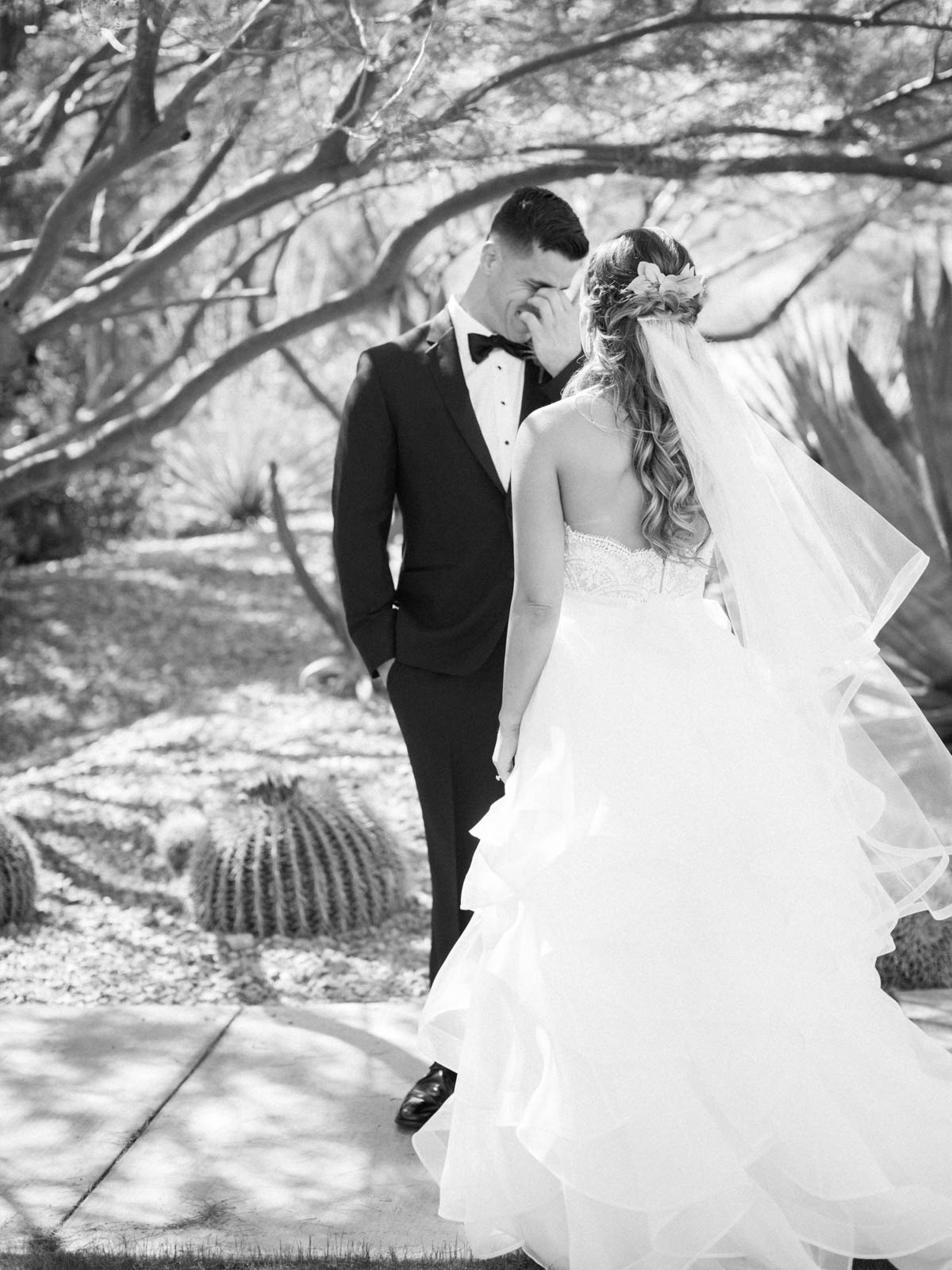 Perfect first look groom's reaction captured by Tucson Wedding Photographers Betsy & John