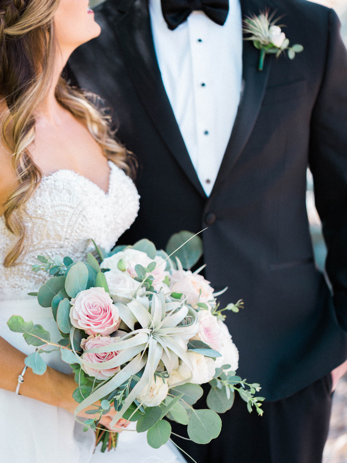 Amazing blush bouquet with air plants and greenery by Alexis Grace Florals captured by Tucson Wedding Photographers Betsy & John