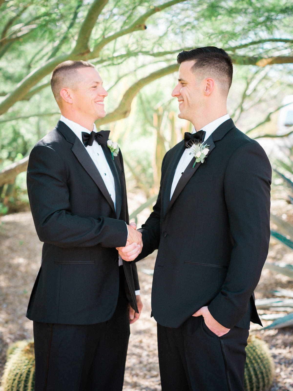 Groom shaking groomsmen hands captured by Tucson Wedding Photographers Betsy & John