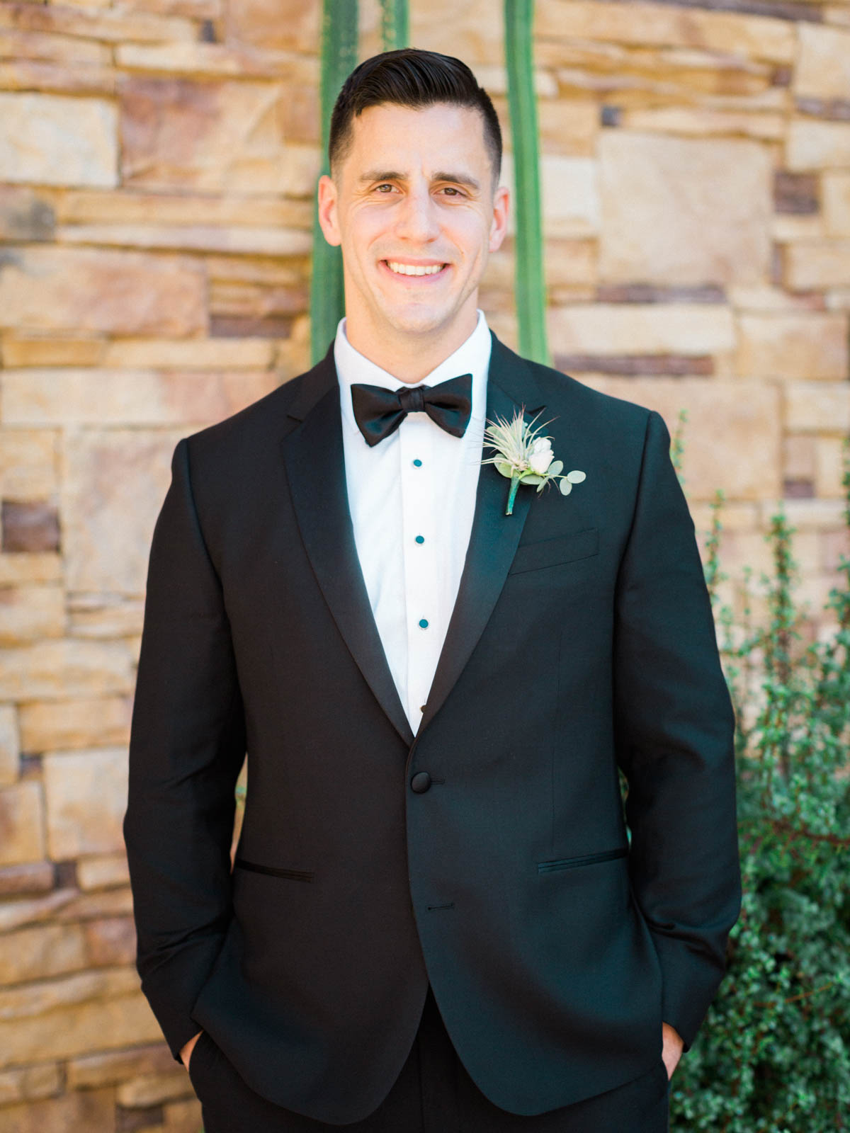 Handsome groom in black tux captured by Tucson Wedding Photographers Betsy & John