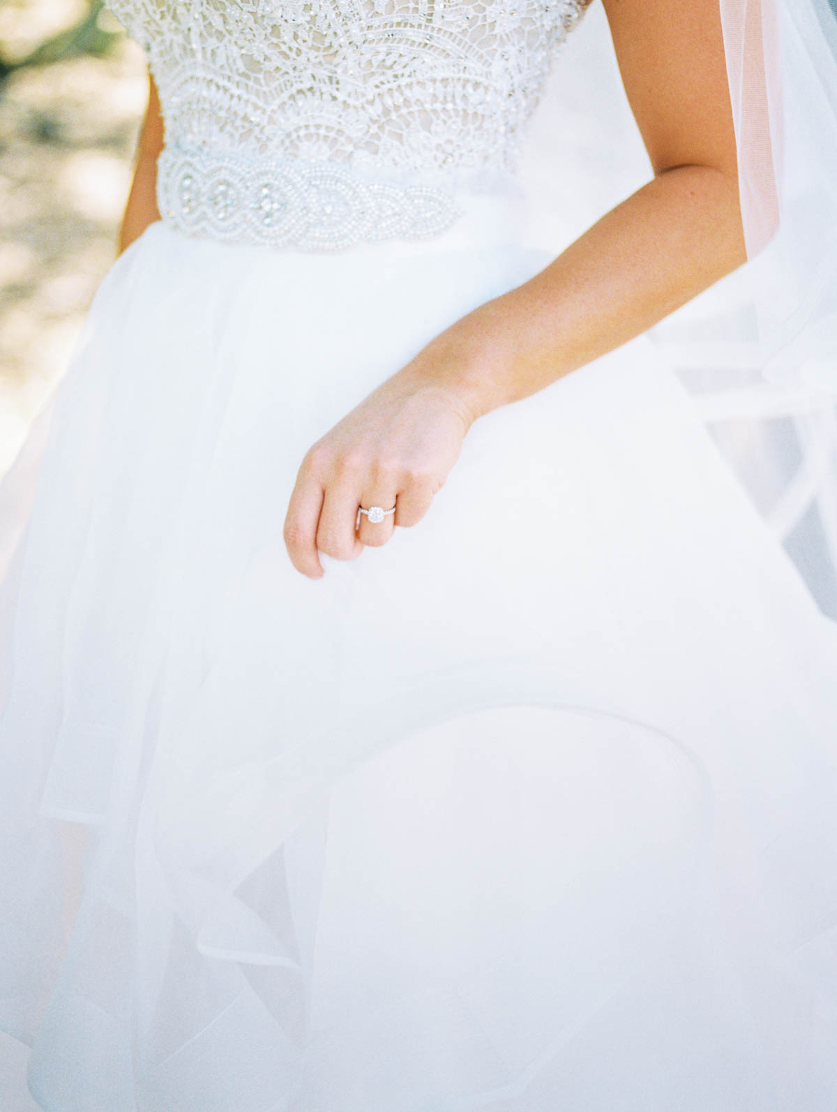 Ring shot and gorgeous gown captured by Tucson Wedding Photographers Betsy & John