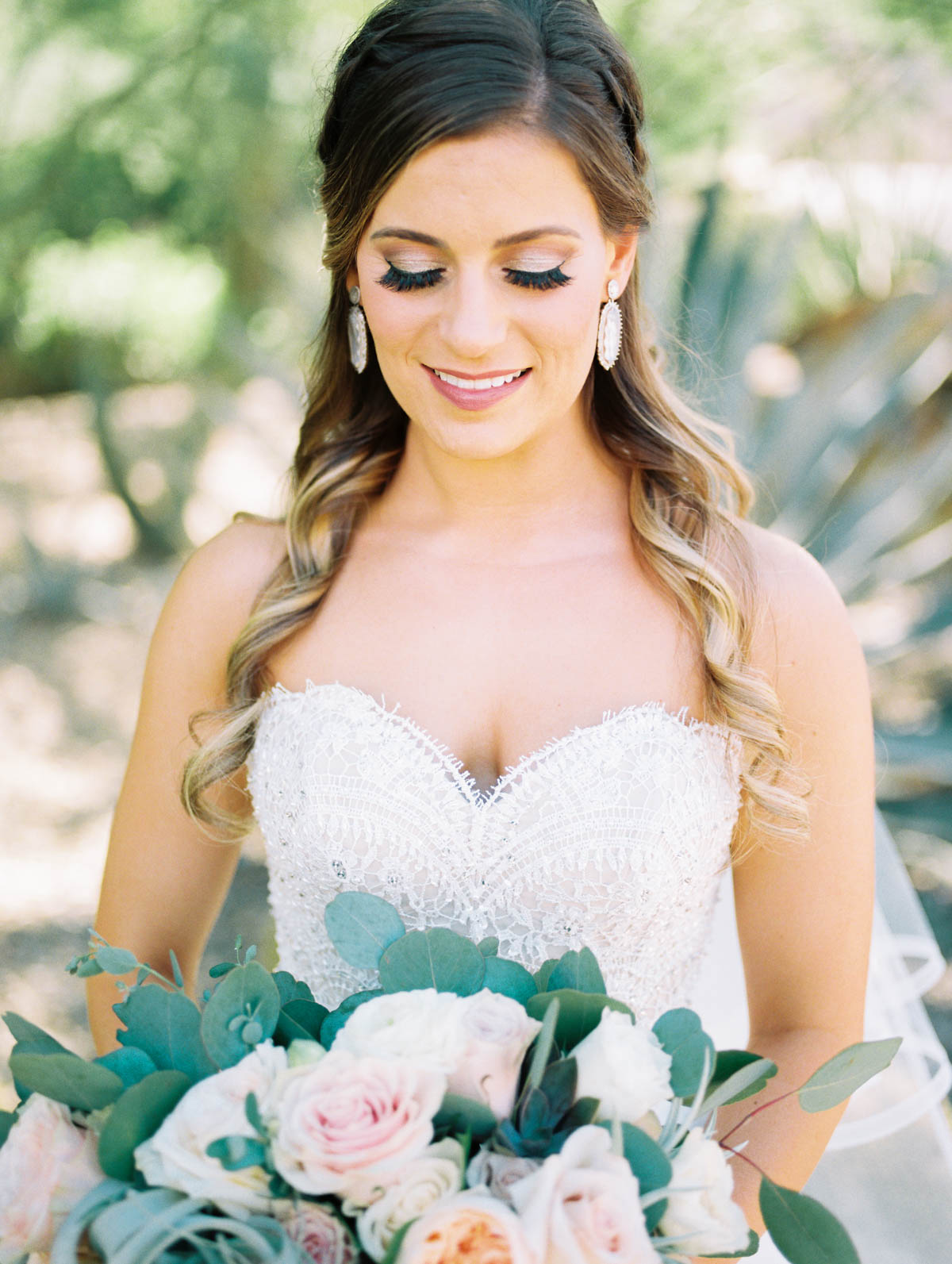 Stunning bride Jamie with hair & makeup by Heather Van Houten captured by Tucson Wedding Photographers Betsy & John