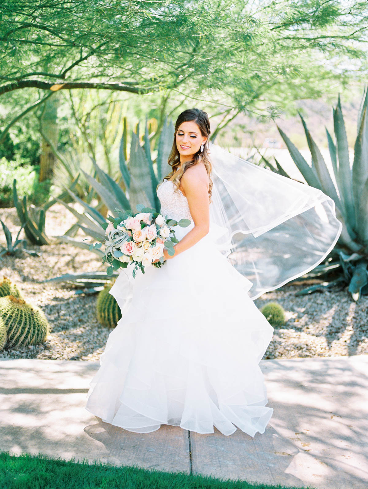 Gorgeous bride with hair and makeup by Heather Van Houten Mike & Jamie's gorgeous day captured by Tucson Wedding Photographers Betsy & John