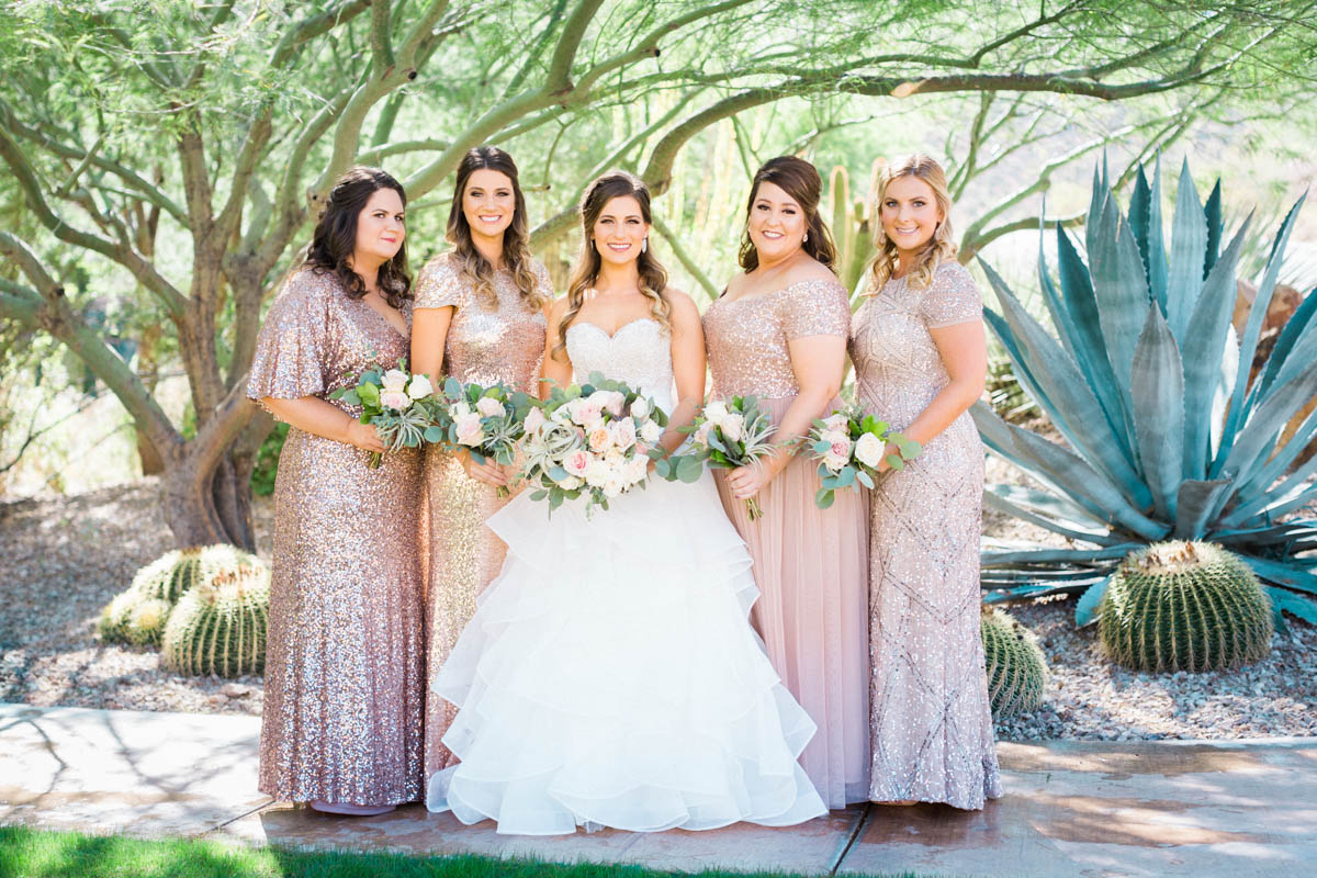 Sparkling blush bridesmaids gowns +blush and white bouquets captured by Tucson Wedding Photographers Betsy & John