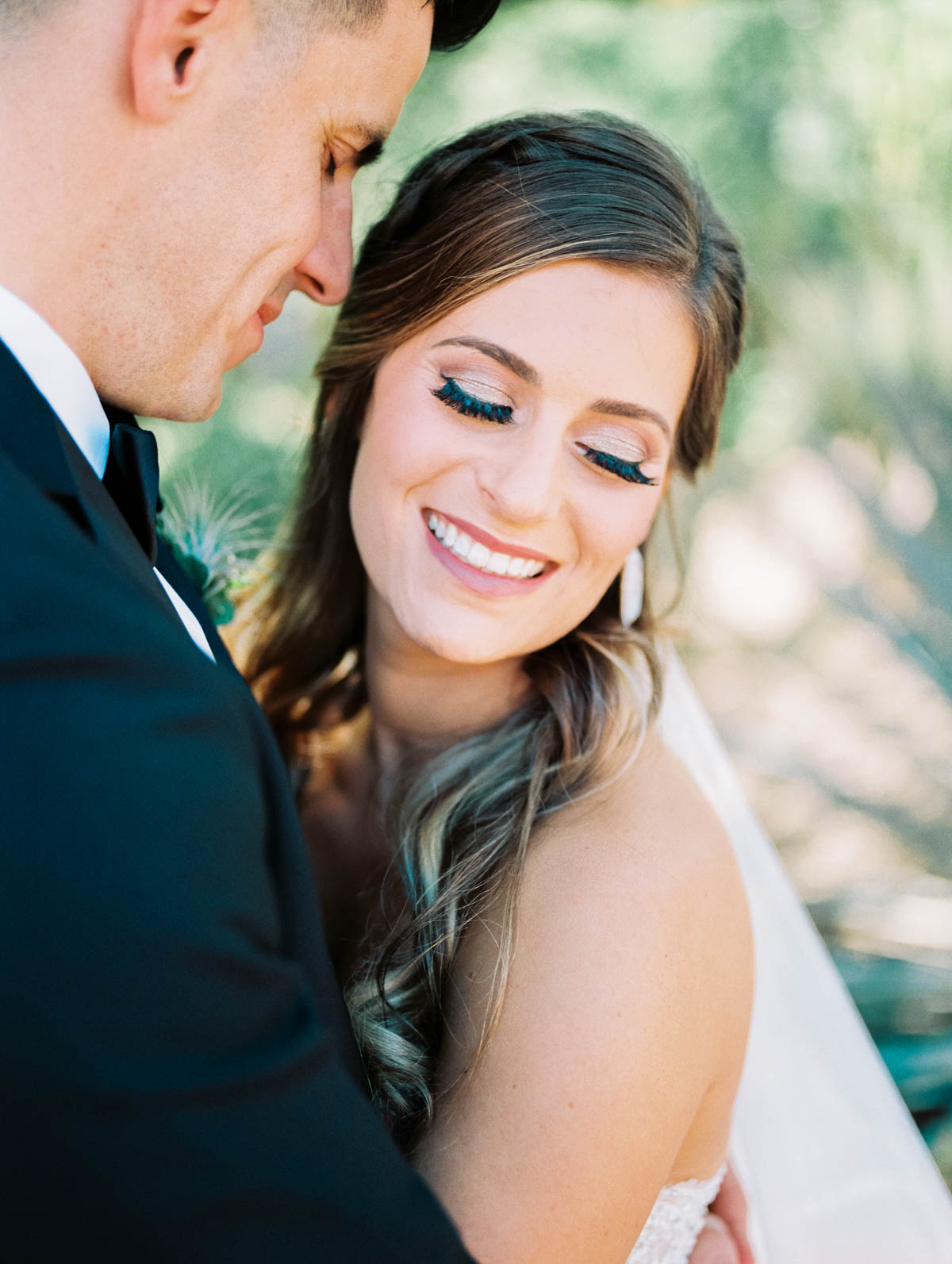 Smiling bride captured by Tucson Wedding Photographers Betsy & John