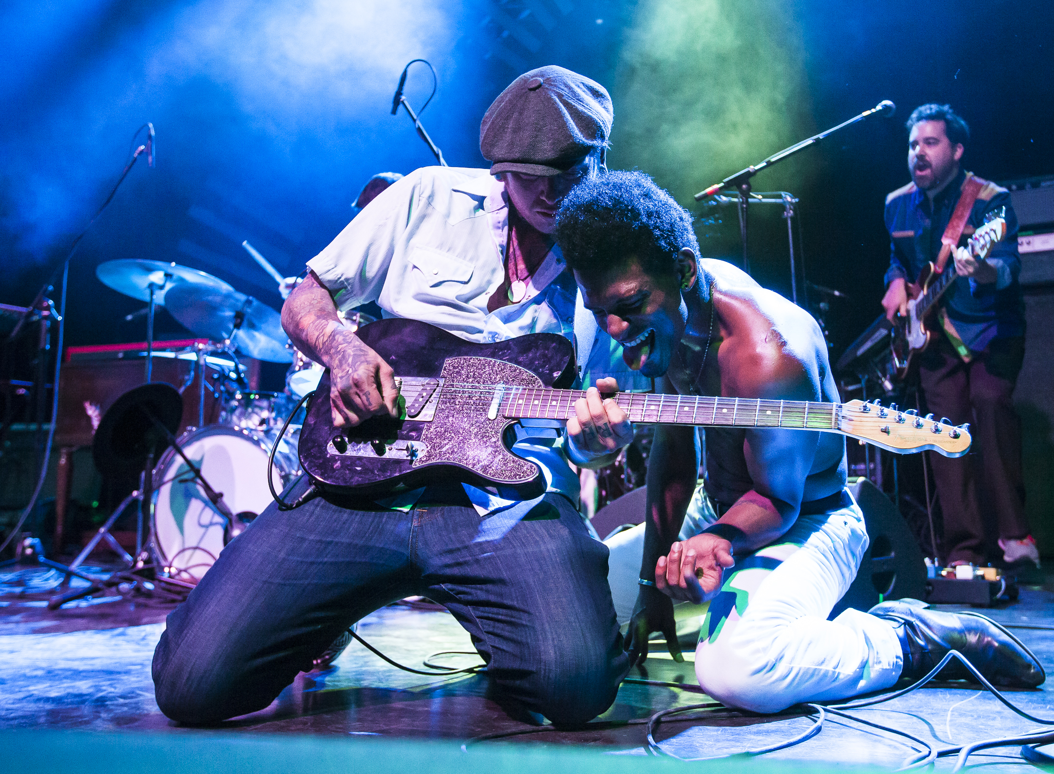 Benjamin Andrew, on guitar, and Ziek McCarter interact during a guitar solo at the end of Con Brio's set at The Wilma Theatre in Missoula, Mont. on Feb. 25, 2016. (Lacey Young, Montana Kaimin)