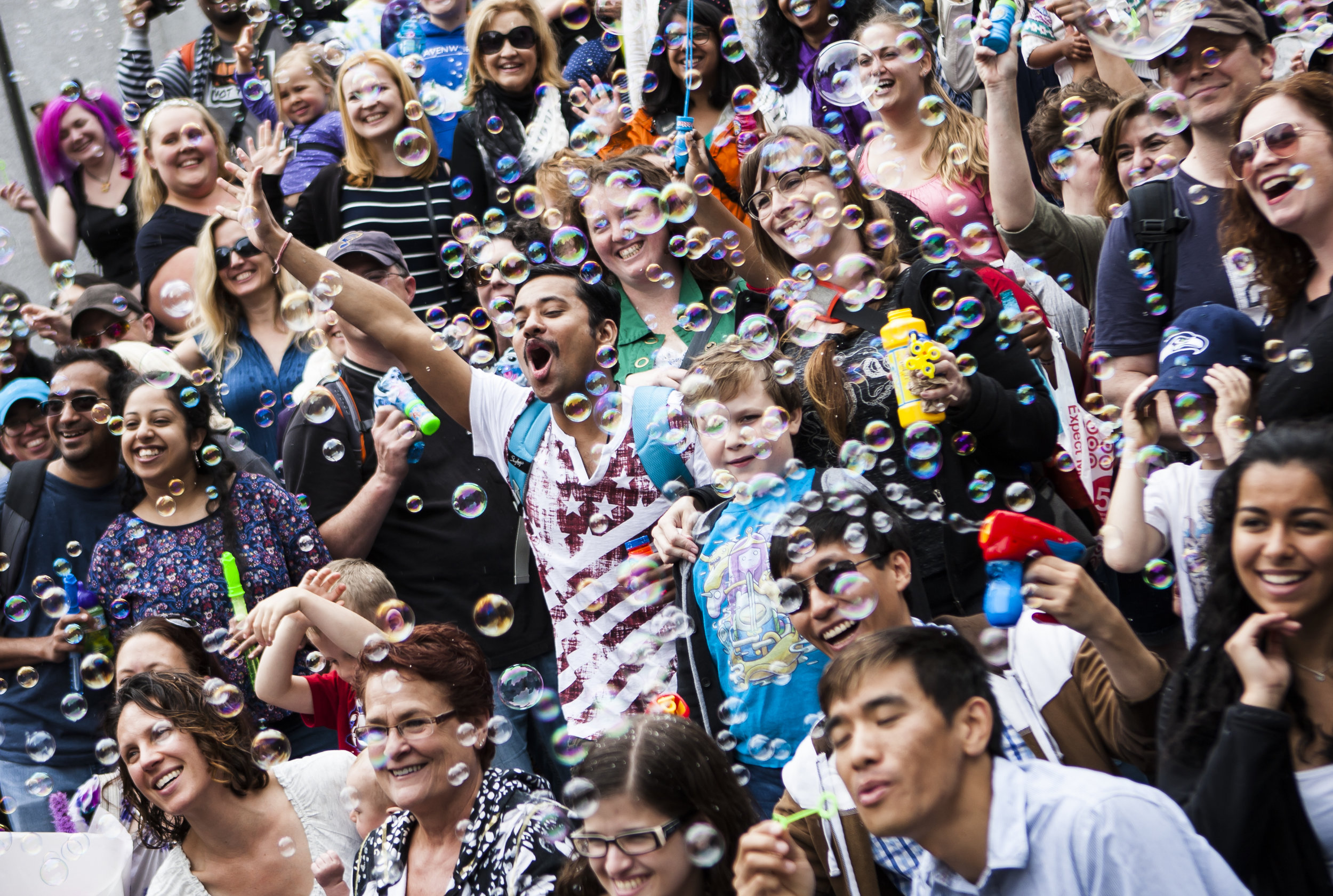 International Bubble Flash Mob participants pose for a group photo post flash mob at Westlake Park in downtown Seattle, Wash. on July 9, 2016. London also participated in the flash mob. (Lacey Young, seattlepi.com)