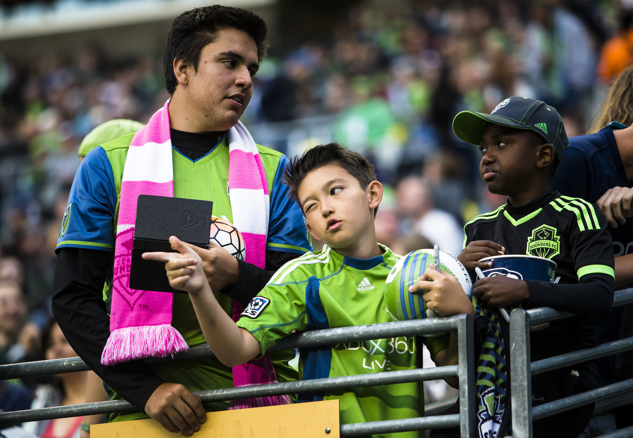 A young fan gives a hand signal to a Sounders player as he walks onto the pitch at CenturyLink Field in Seattle, Wash. on July 5, 2016.  (Lacey Young, seattlepi.com)