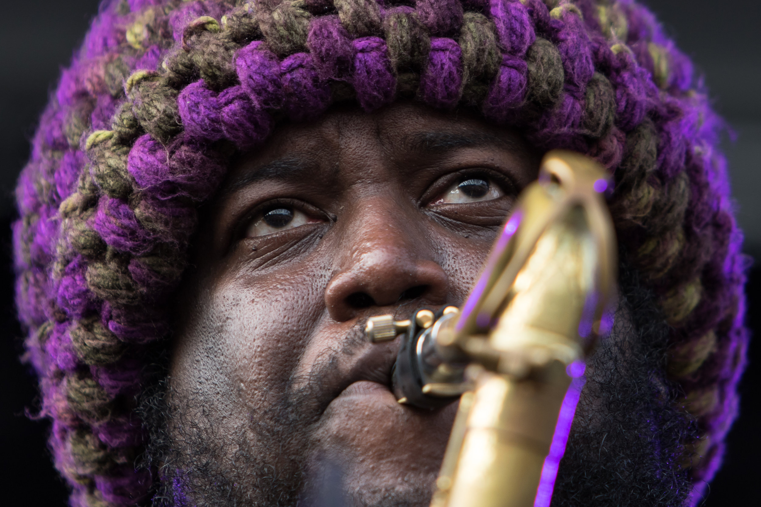 Tenor saxophone player Kamasi Washington plays for a sold-out crowd during Rock the Garden in Minneapolis, Minn. on June 16, 2018. (Lacey Young, The Current)