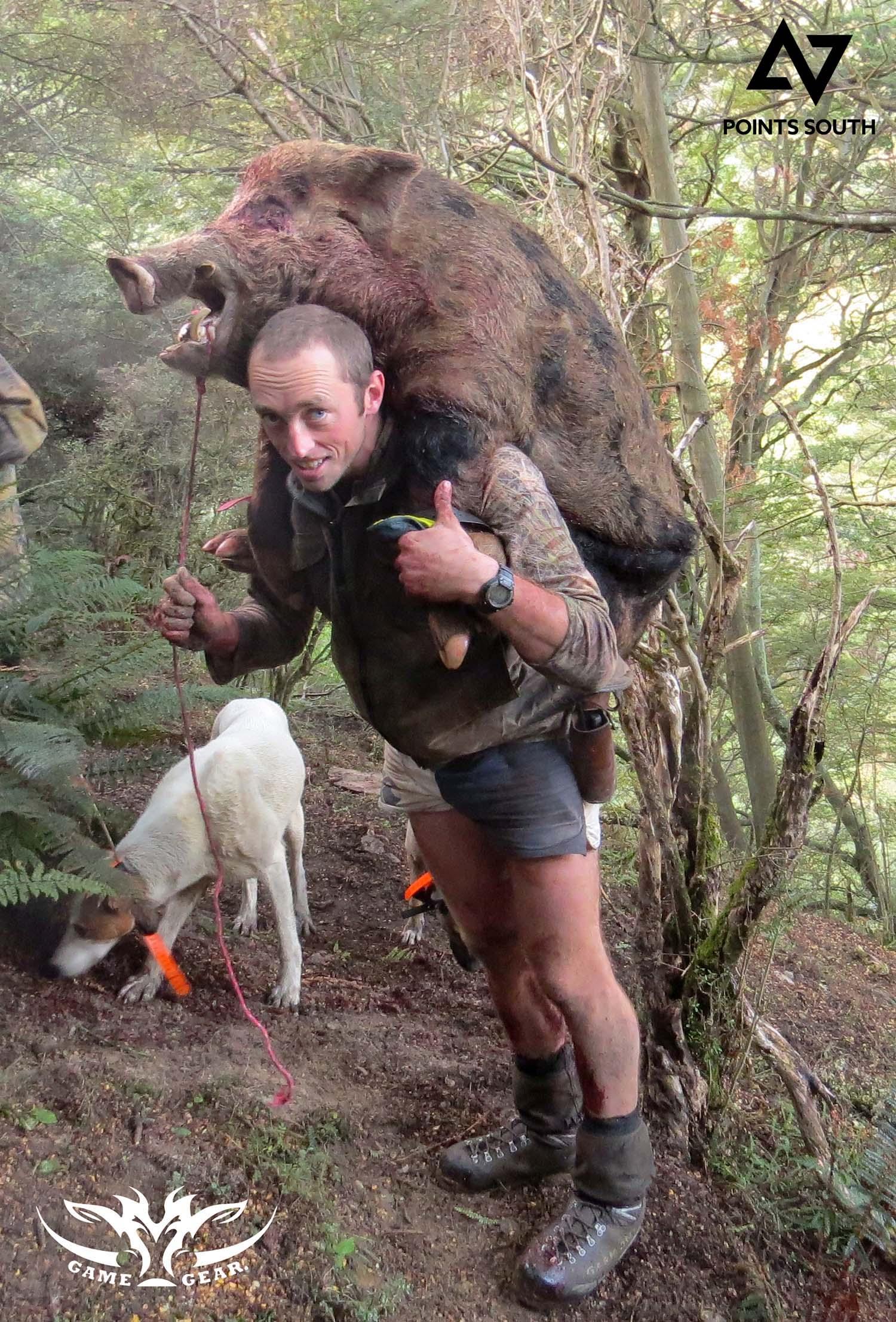 Ryan Carr carrying 270 lb of wild boar