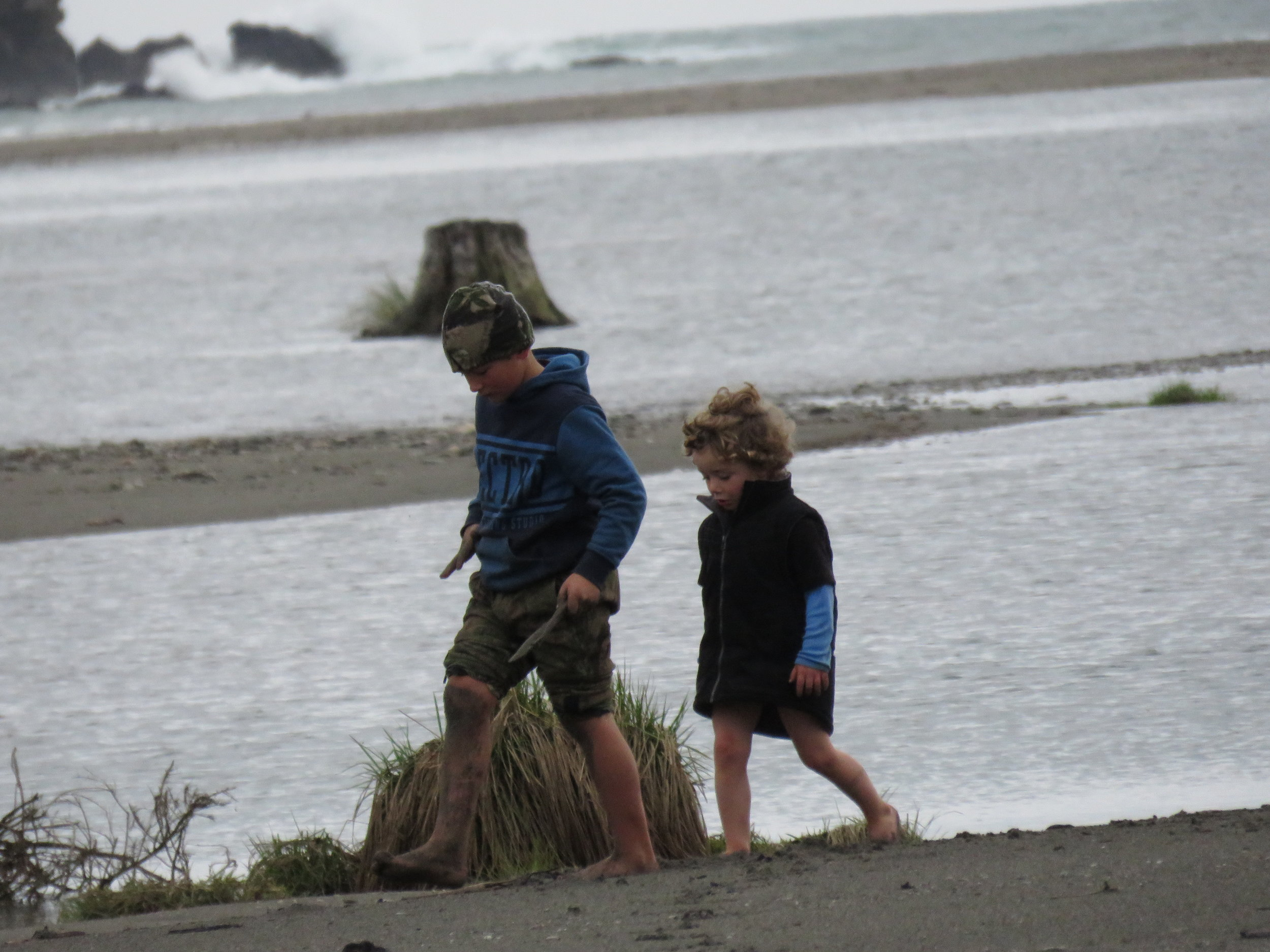 Serious George (7) and his cousin James (3) looking for a better spot to set their whitebait net.