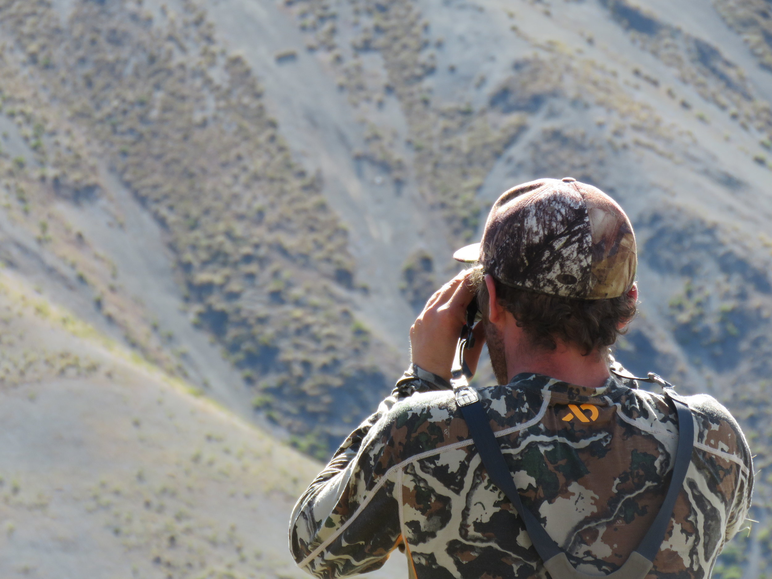 """Cam McKay looking for trophy rabbits and giving the """" Wilkin"""" merino base long sleeve  top a good work out. A new product coming to New Zealand from First Lite."""