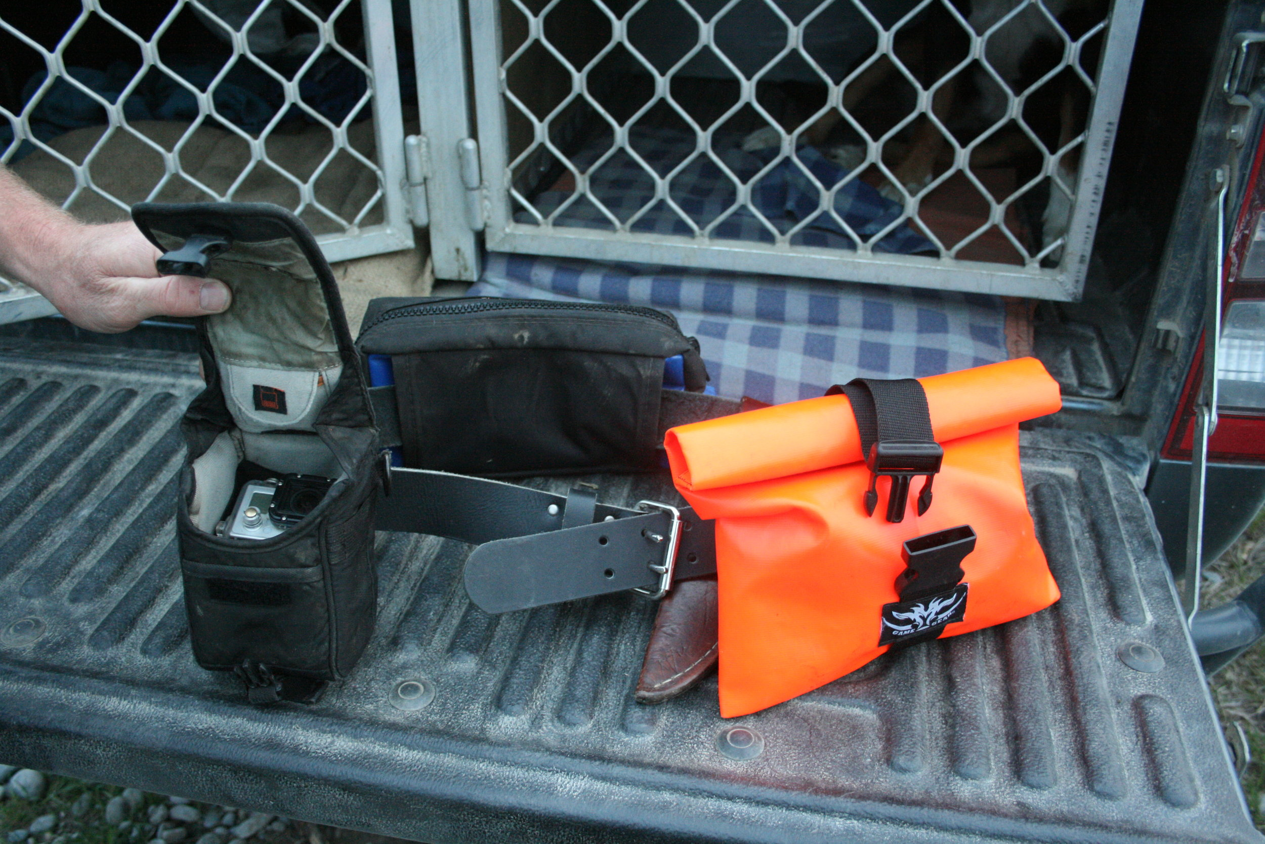 Having the camera gear in protective bags on a belt is a useful way to give quick access when the action suddenly starts.