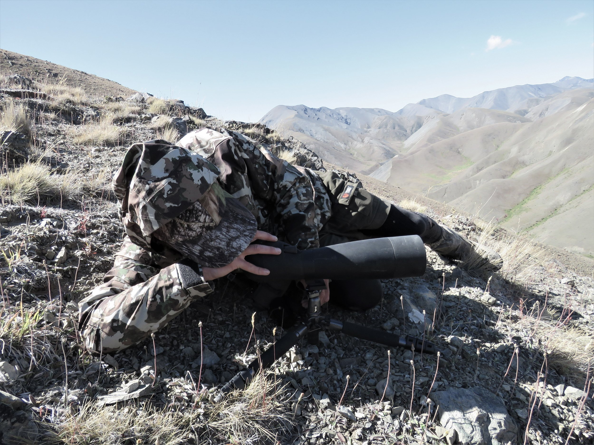 Cam McKay on the spotter, bloody hard to operate in the strong wind, but he has seen something worth a closer inspection! The First lite Fusion Camo is pretty neat too.