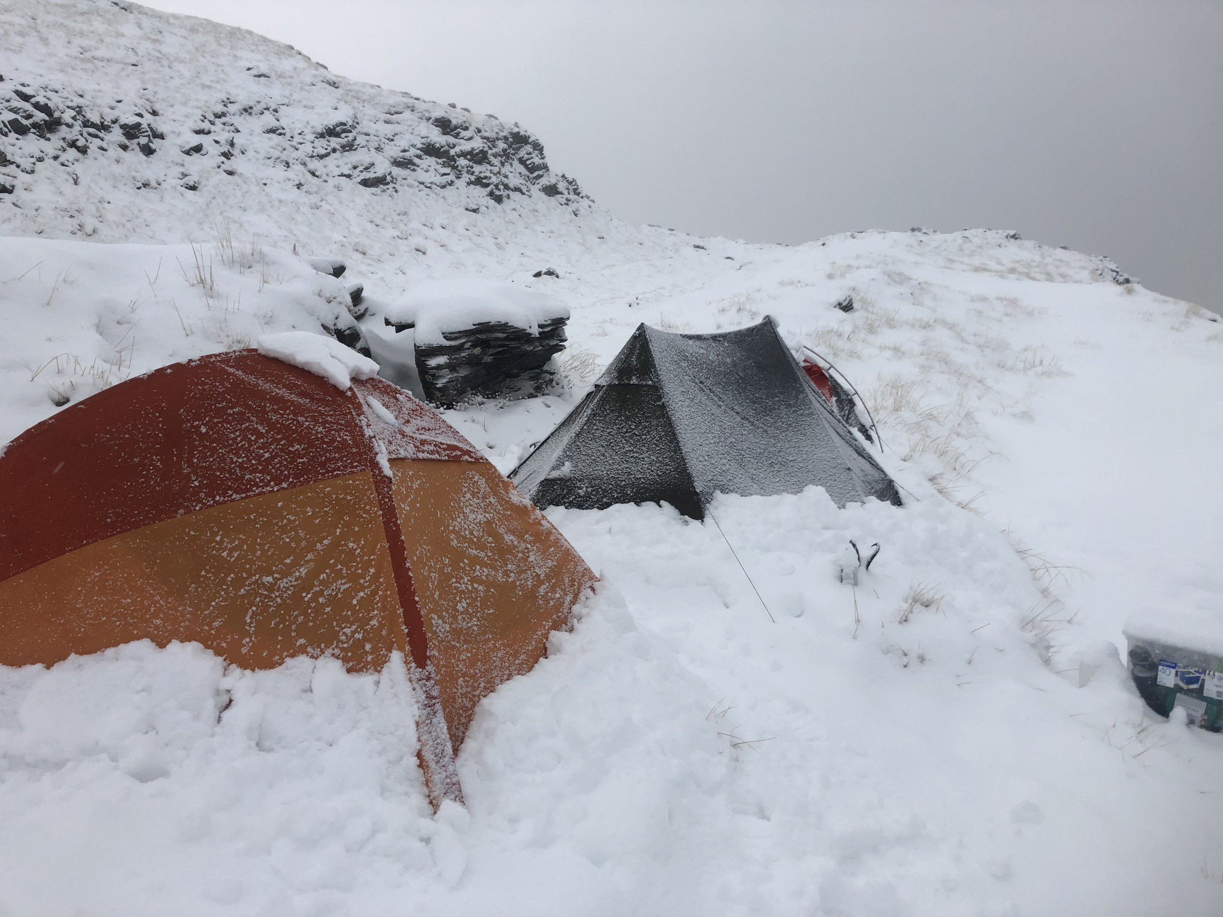 Still a surprisingly warm night with the fresh snow on the tents
