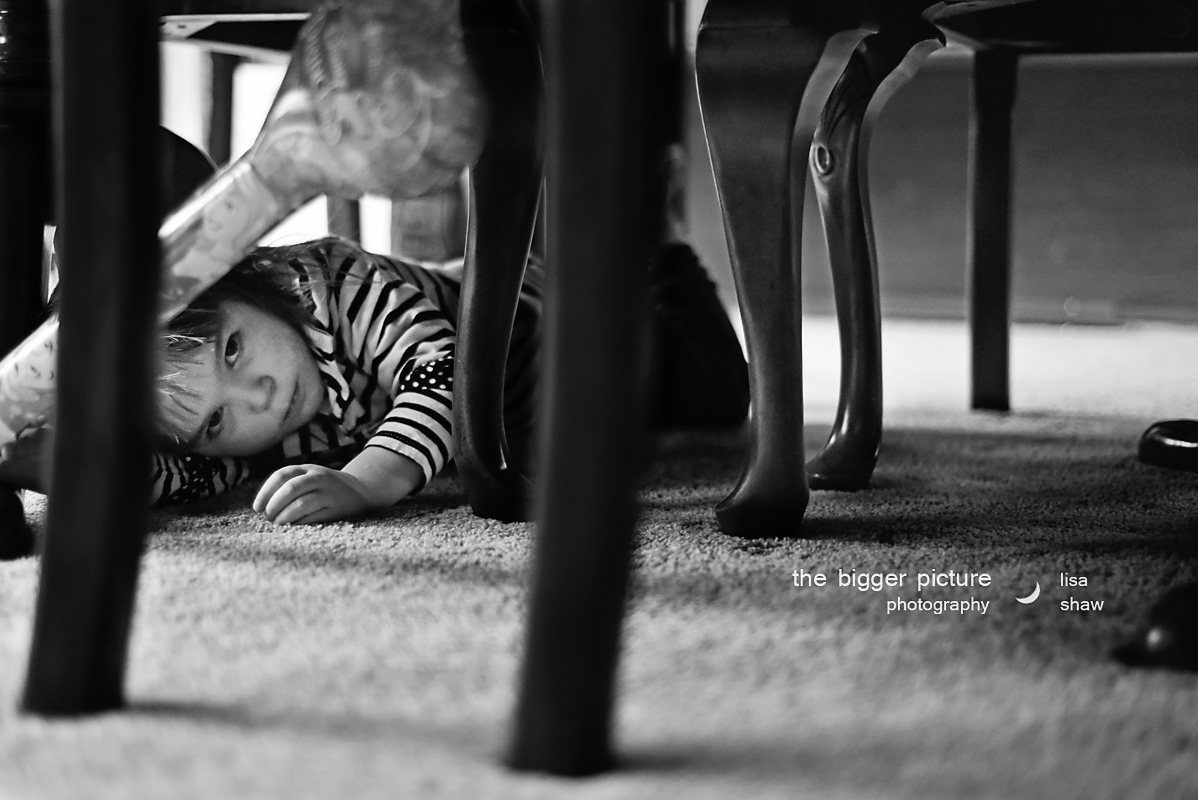 Maria (3yrs old) just hit her brother. Joshie cried and was consoled by mom. Whenever Maria gets reprimanded for bad behavior, she pouts and broods under the table for a bit. 5 minutes later, Joshie crawls in to comfort his sister, who just hurt him. He even holds her hand when she sticks her tongue out at him.  Awwwww. What amazing qualities! Quick to forgive, compassion, and love! They came out together smiling. This is documentary family photography. It says a lot more than if these two were just smiling at the camera. Just sayin'.