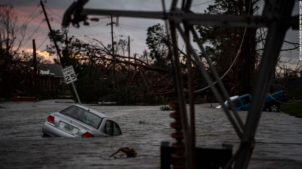Floodwaters overwhelm vehicles in Panama City on Wednesday, October 10, 2018. Photo from CNN https://www.cnn.com/2018/10/11/us/hurricane-michael-tropical-storm-wxc/index.html