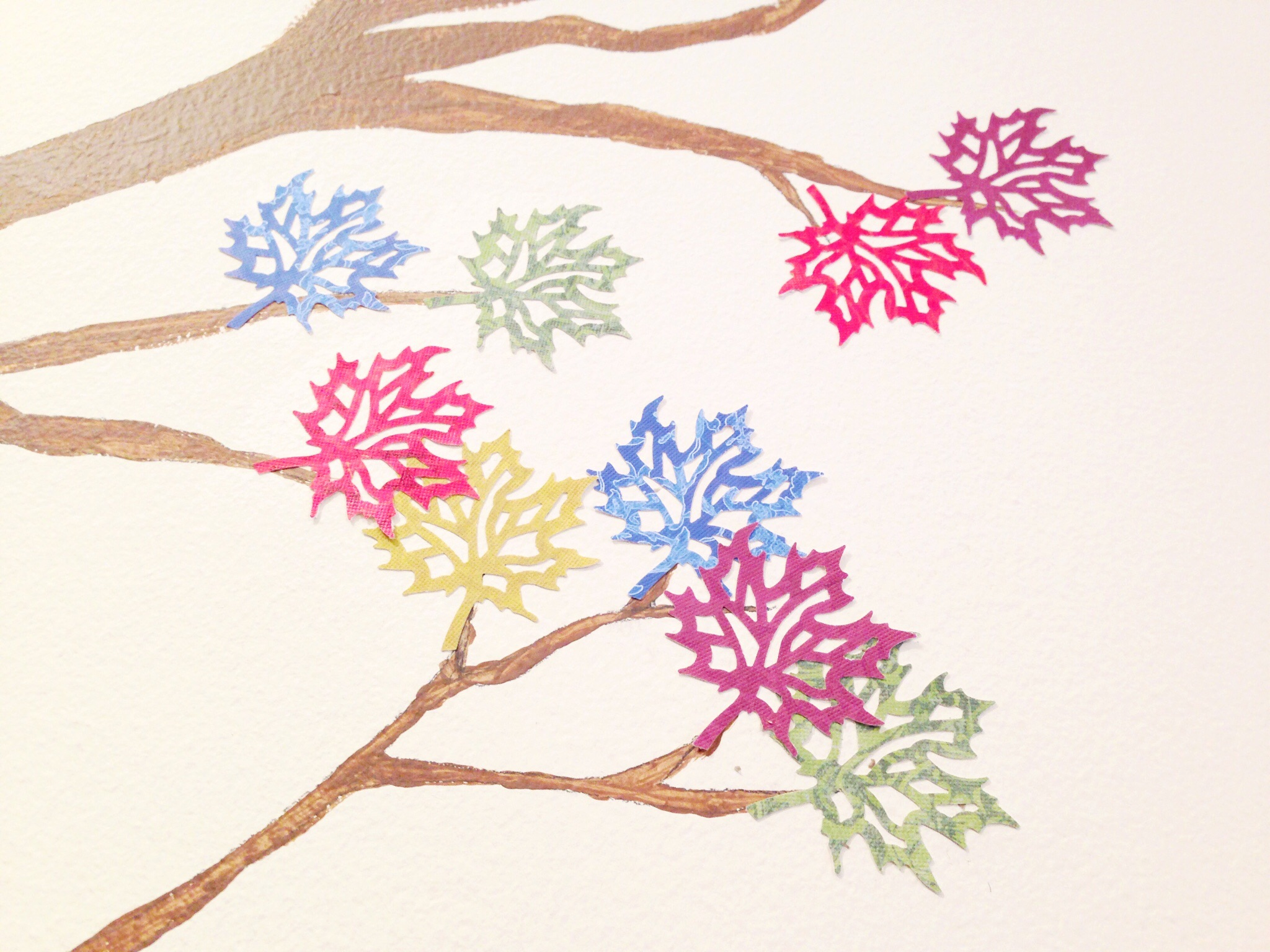...then I used a paper punch for the leaves and painted them on with glue.