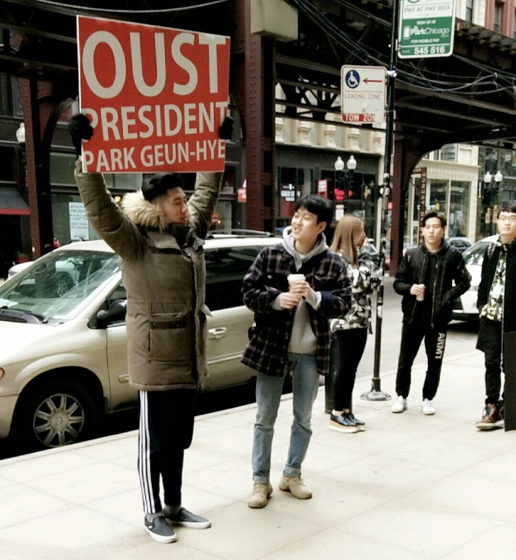The  Oust Project  performance in front of SAIC's Sharp building, February 2017. Photograph by Jinchen Cai.