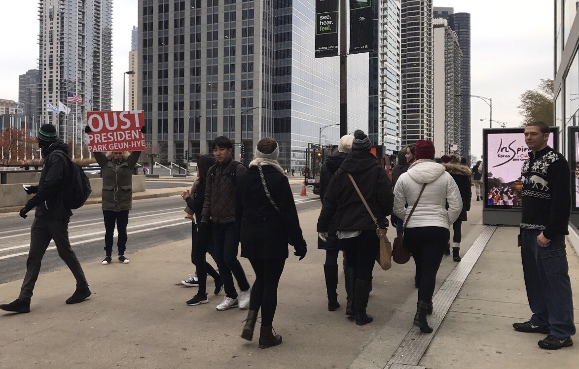 """The  Oust Project  performance in front of Harris Theater, at the """"Inspired Korea in Chicago"""" (event organized by the Consulate General of the Republic of Korea and Korean Cultural Center of Chicago) in December, 2016. Photograph by Da-eun Hong."""