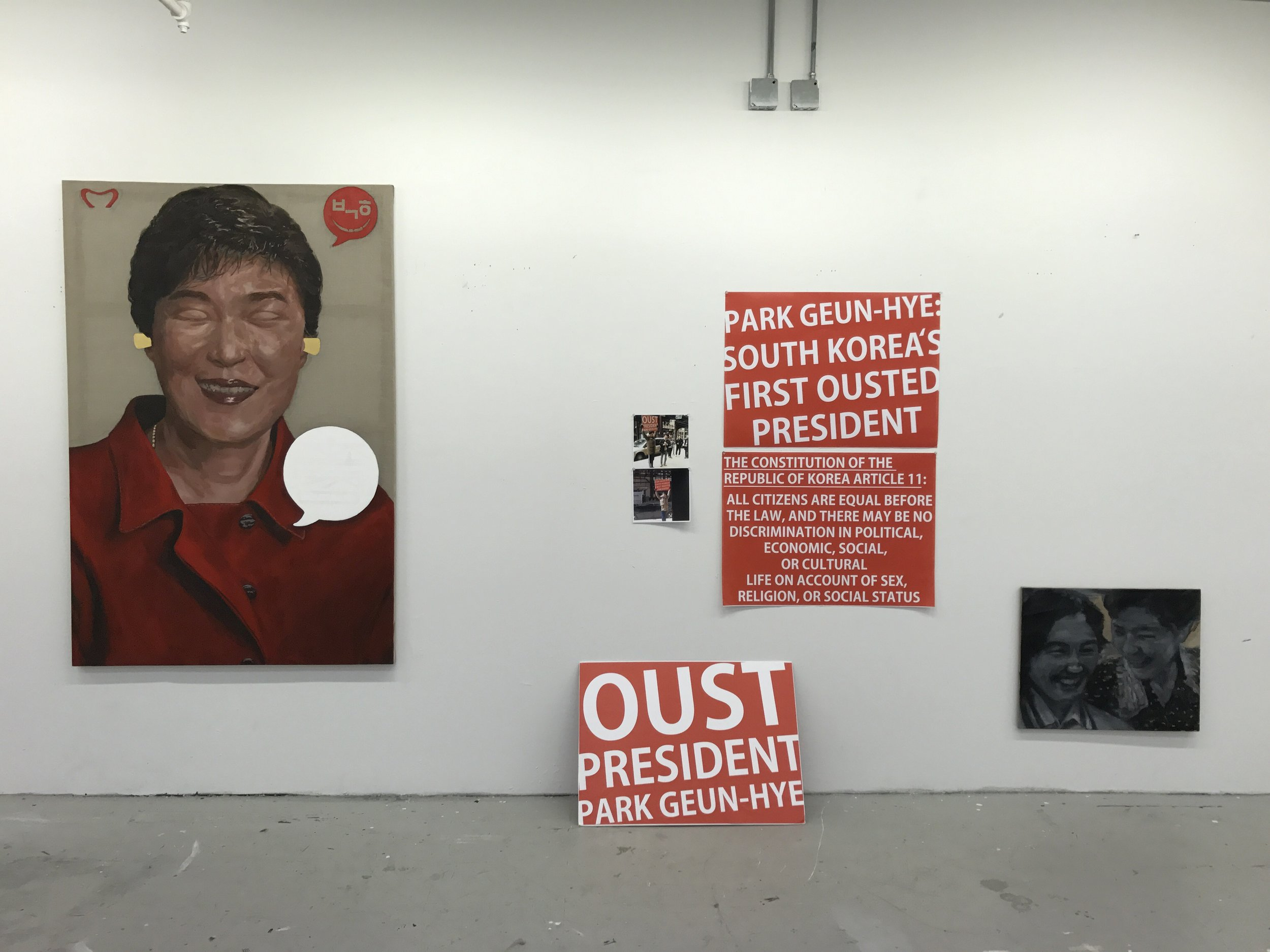 Installation of  Oust Project  artworks (Left to right):  Creative Economy  (2017),  Replaceable Protest Banner  (2016-17),  President and Her BFF (Best Friend Forever)  (2016)