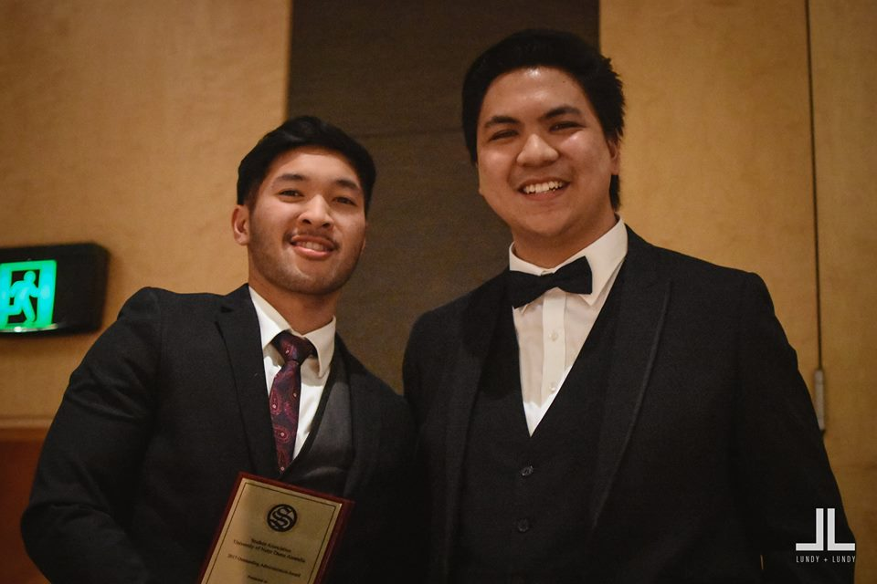 L to R: Aurel Menzon, Nursing President, accepting the award from Christian Santos, Student Association President.