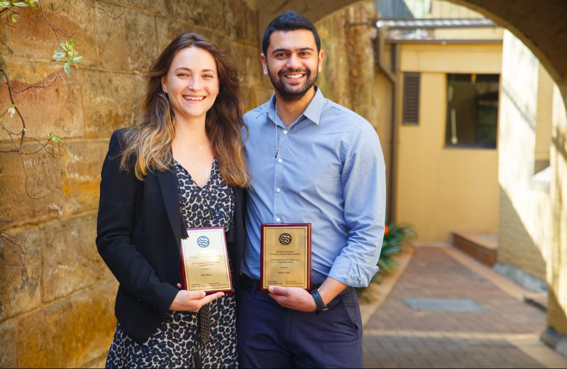 L to R: Kate Mazey and Jeremy Saad with their individual awards for Outstanding Club Marketing and Engagement.