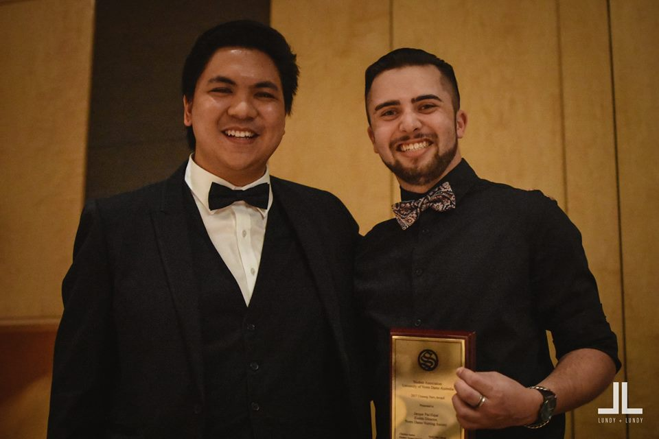 L to R: Christian Santos, Student Association President, presenting the Unsung Hero Award to Jacques Pacifique.