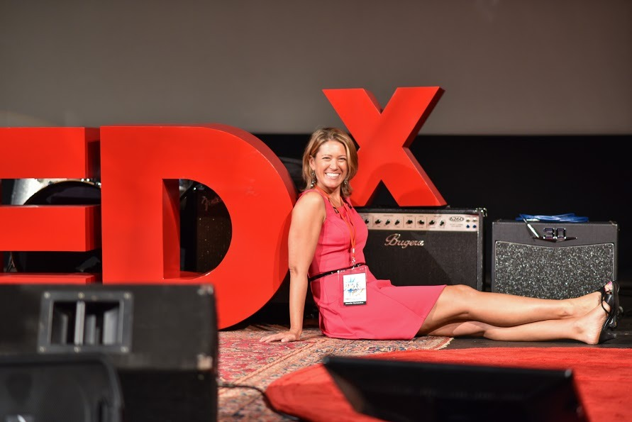 tedx_sign_sitting_closer.jpg