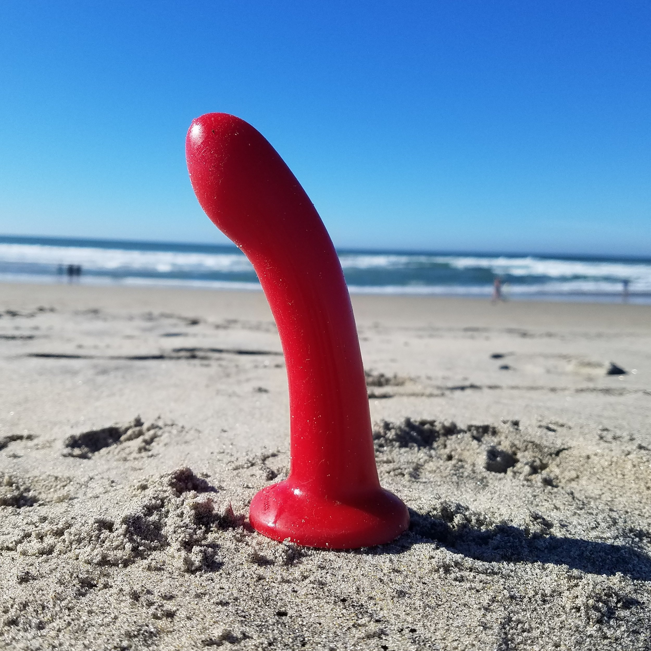 Red dildo on beach Sex Toys.jpg
