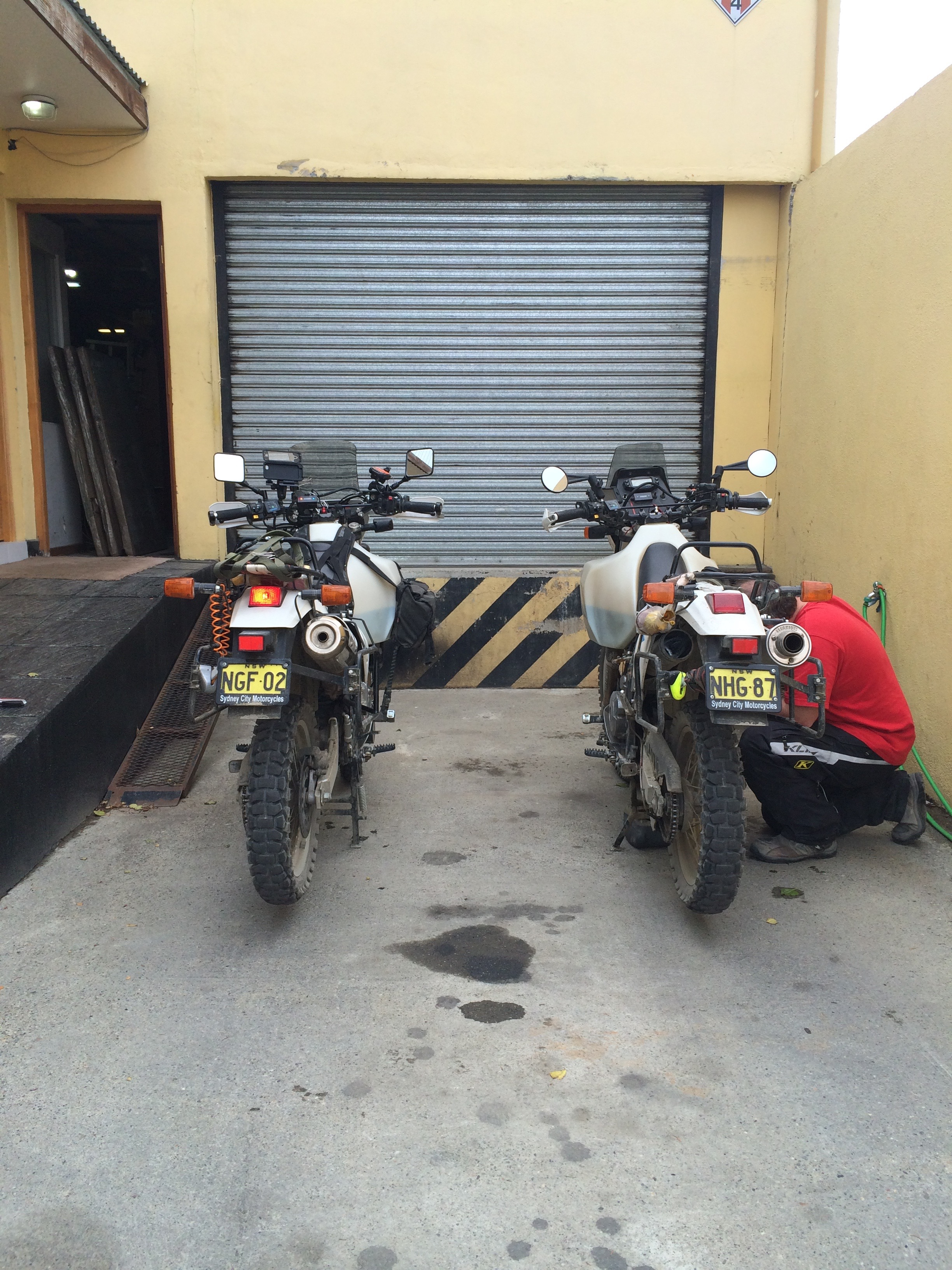 Changing oil at the back of the bike shop