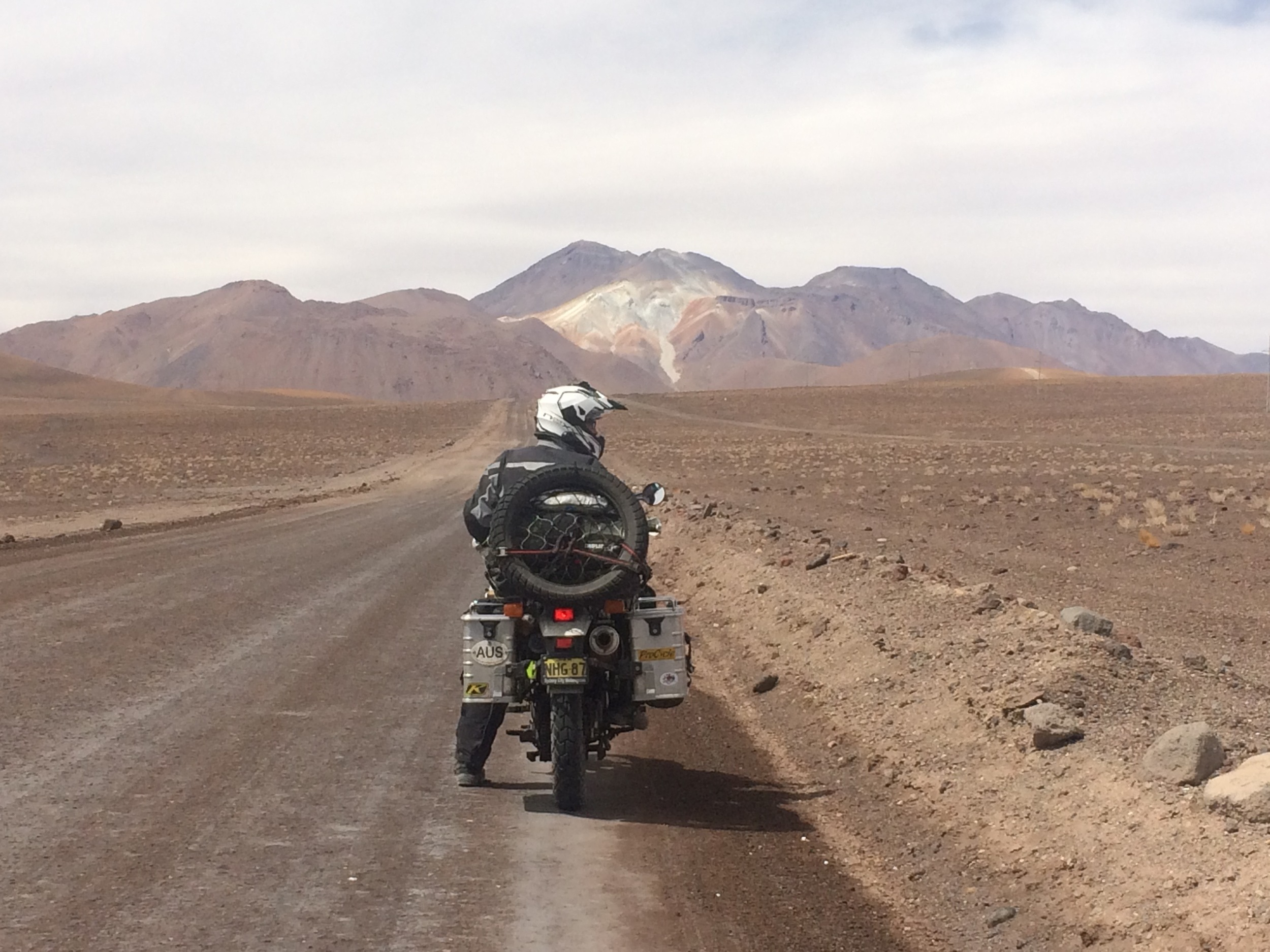 On the road to Uyuni, Bolivia. Old volcano in the background.