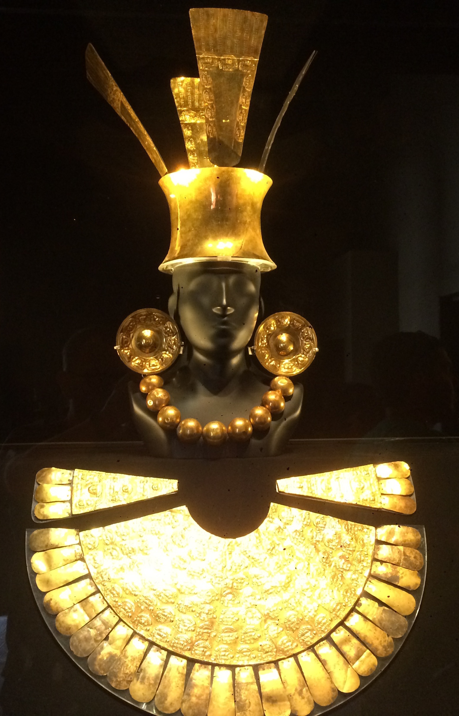 By far the most visually impressive piece is this gold funerary offering from the Chimu culture.