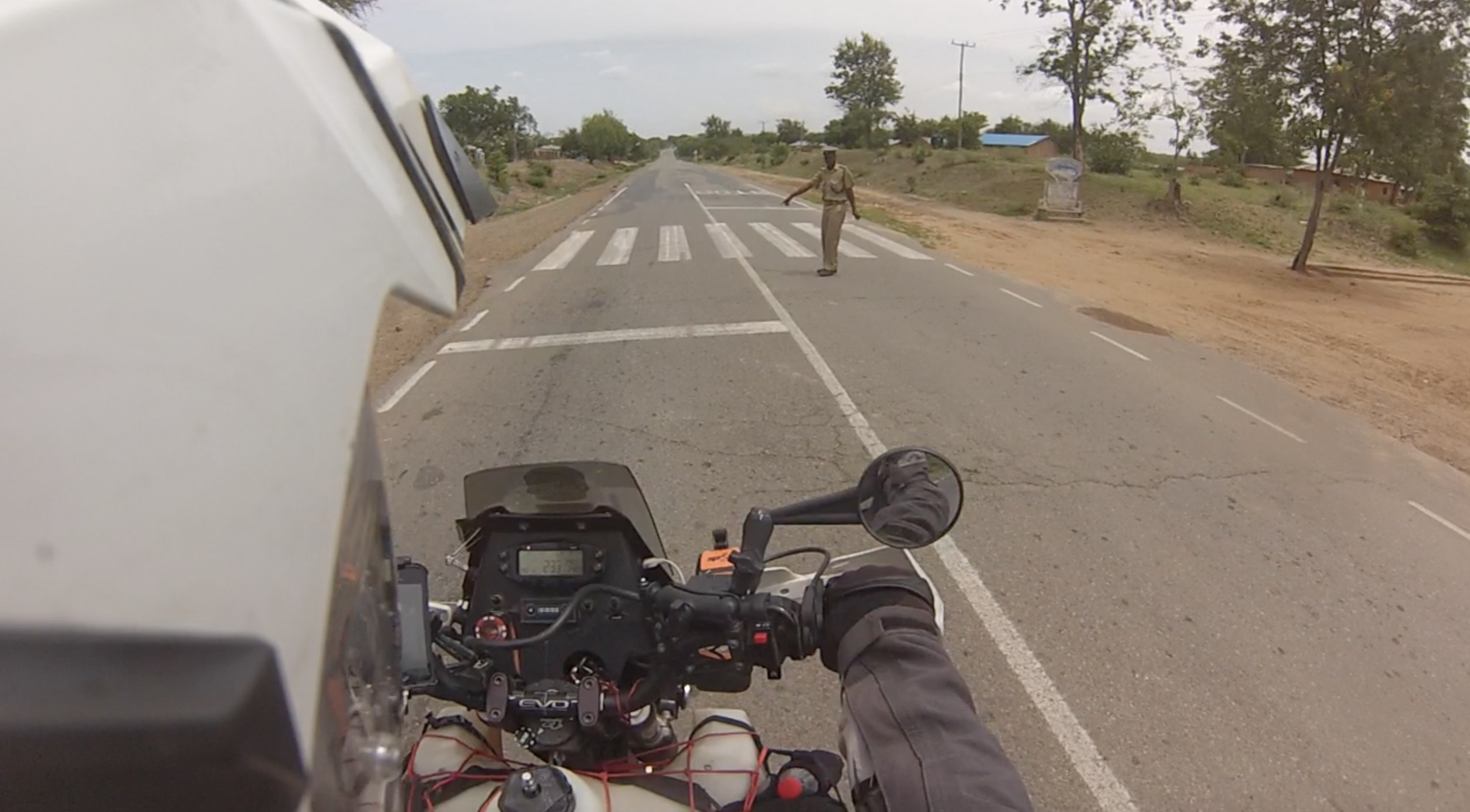 You be the judge. I pull up right where he's pointing, and he fines me for not stopping on the white line.