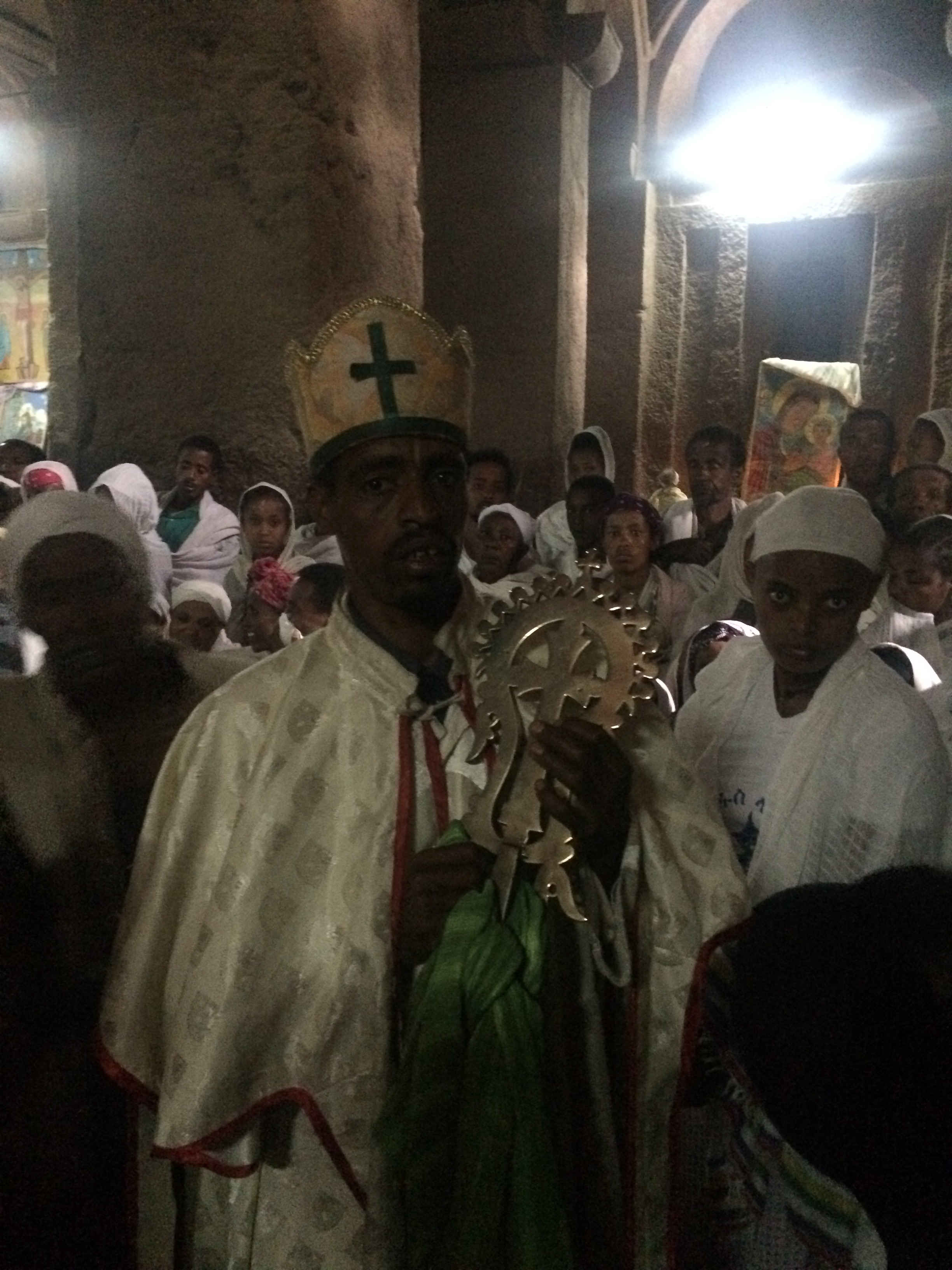 The priest giving blessings to the worshippers - and me and Jeff.