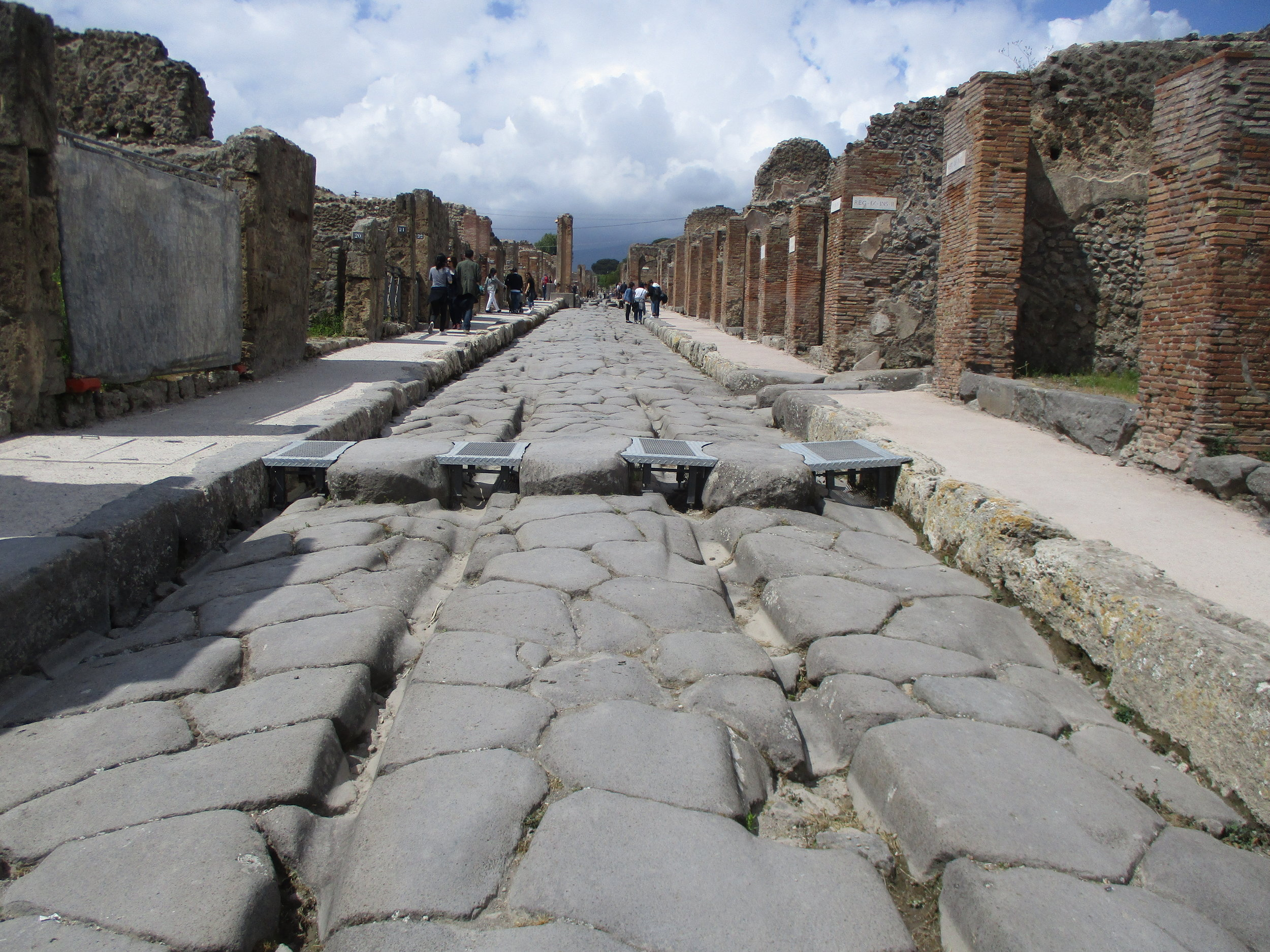 The streets of Pompeii. See the wagon tracks and the stone blocks used for crossing the road to keep your feet (and toga) dry. All amazingly preserved!