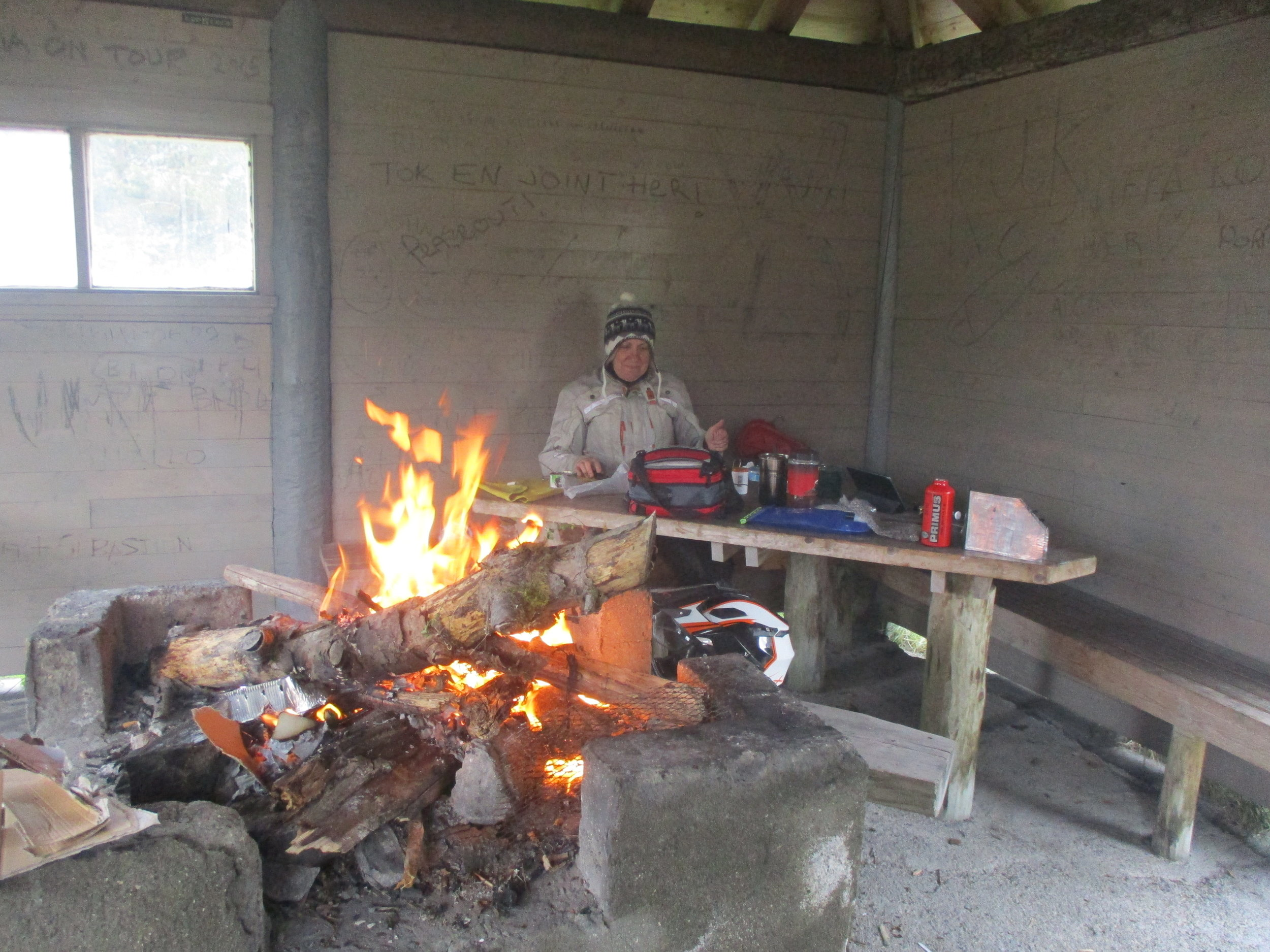 A picnic spot hut with a fire pit.