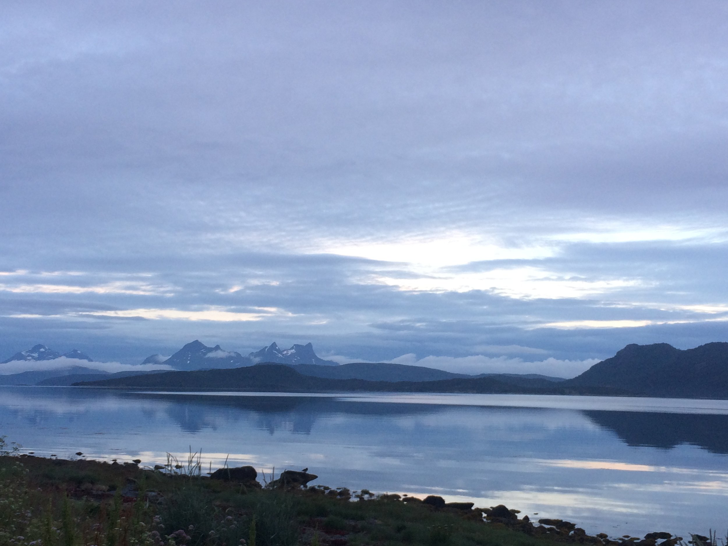 The Midnight Sun over a fjord outside our hut