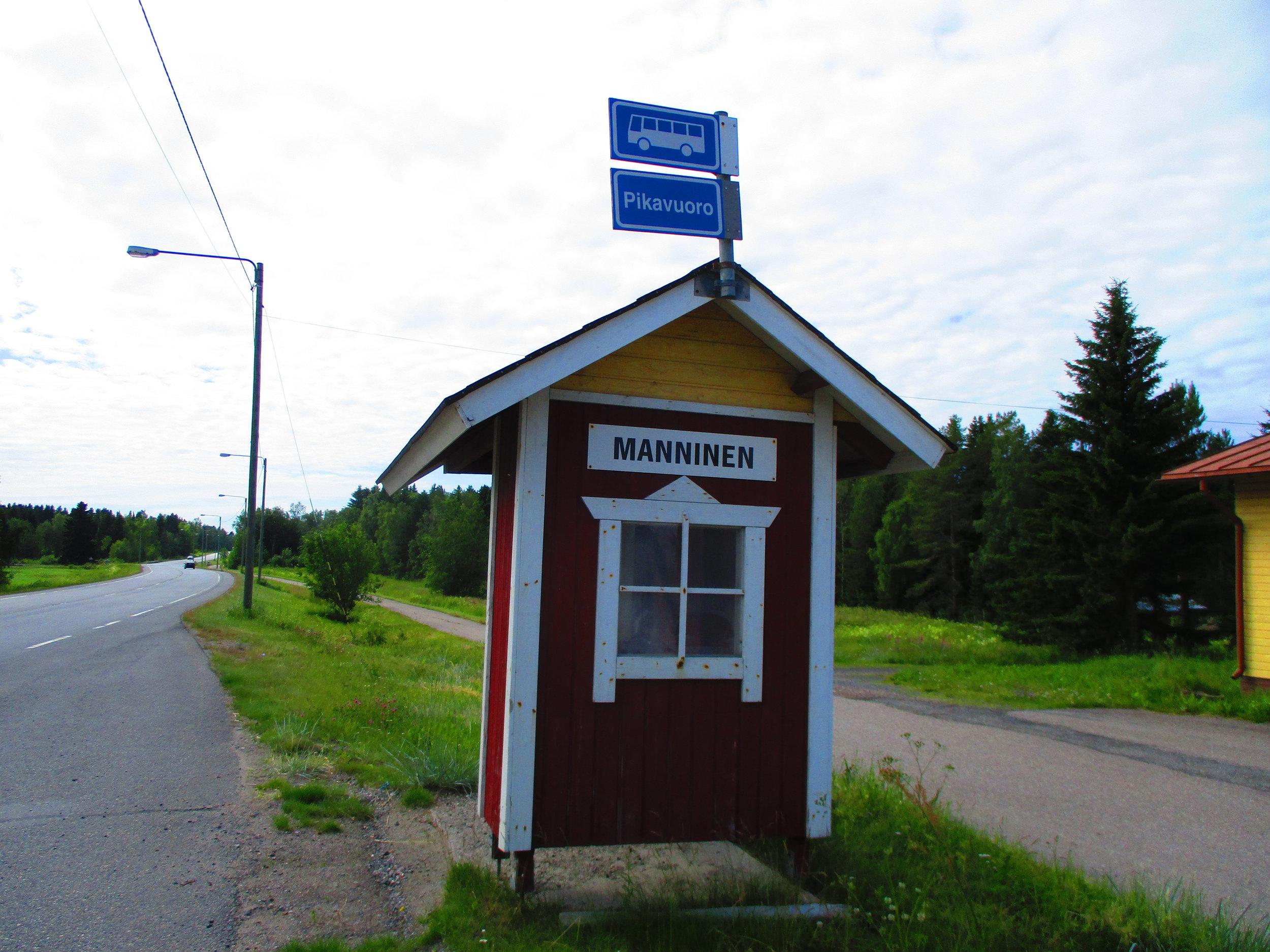 A bus stop through the countryside.