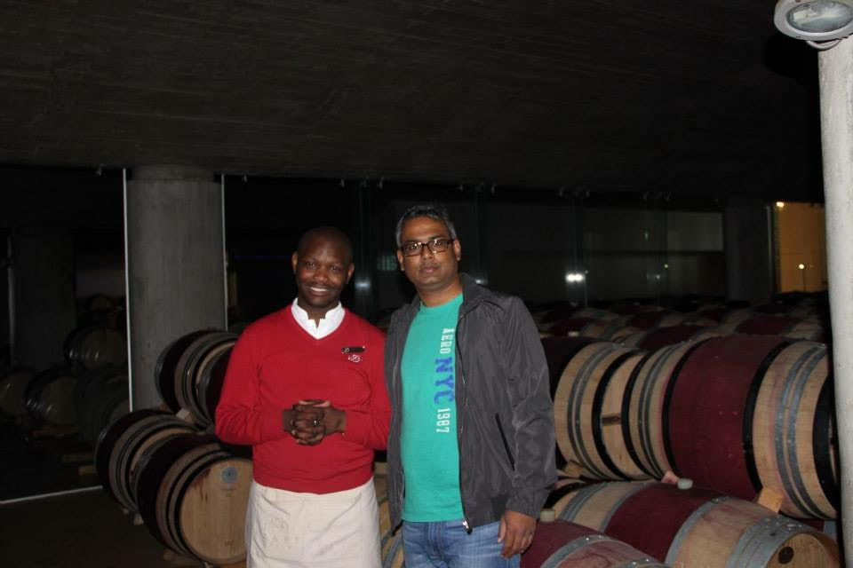 Hubby dear in front of wine maturing in barrels