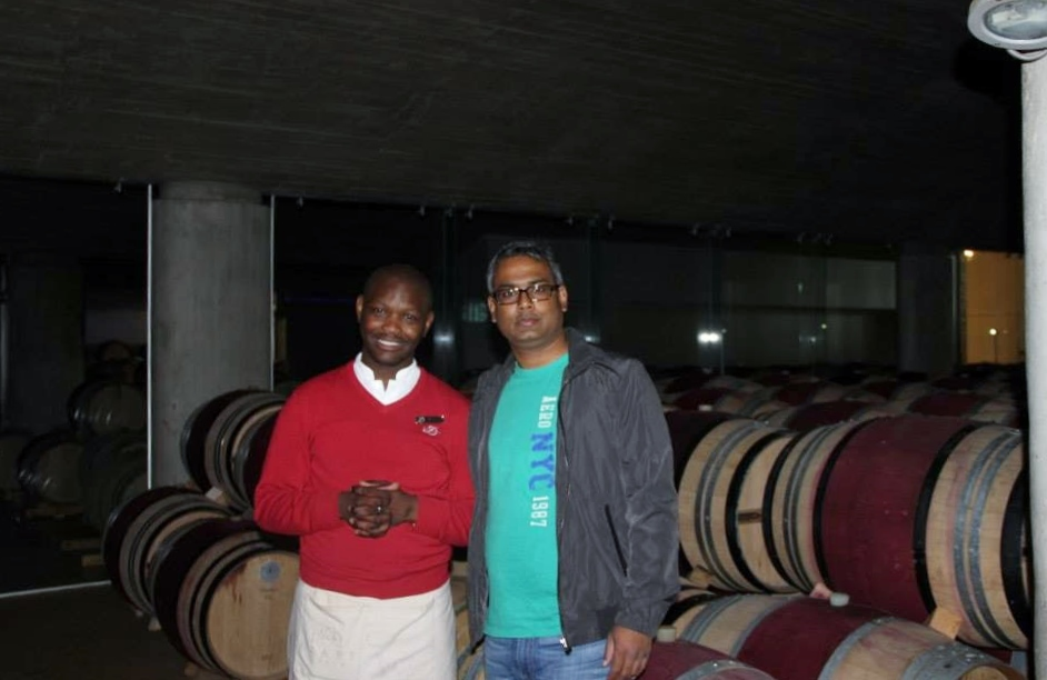 Hubby dear in front of wines maturing in barrels