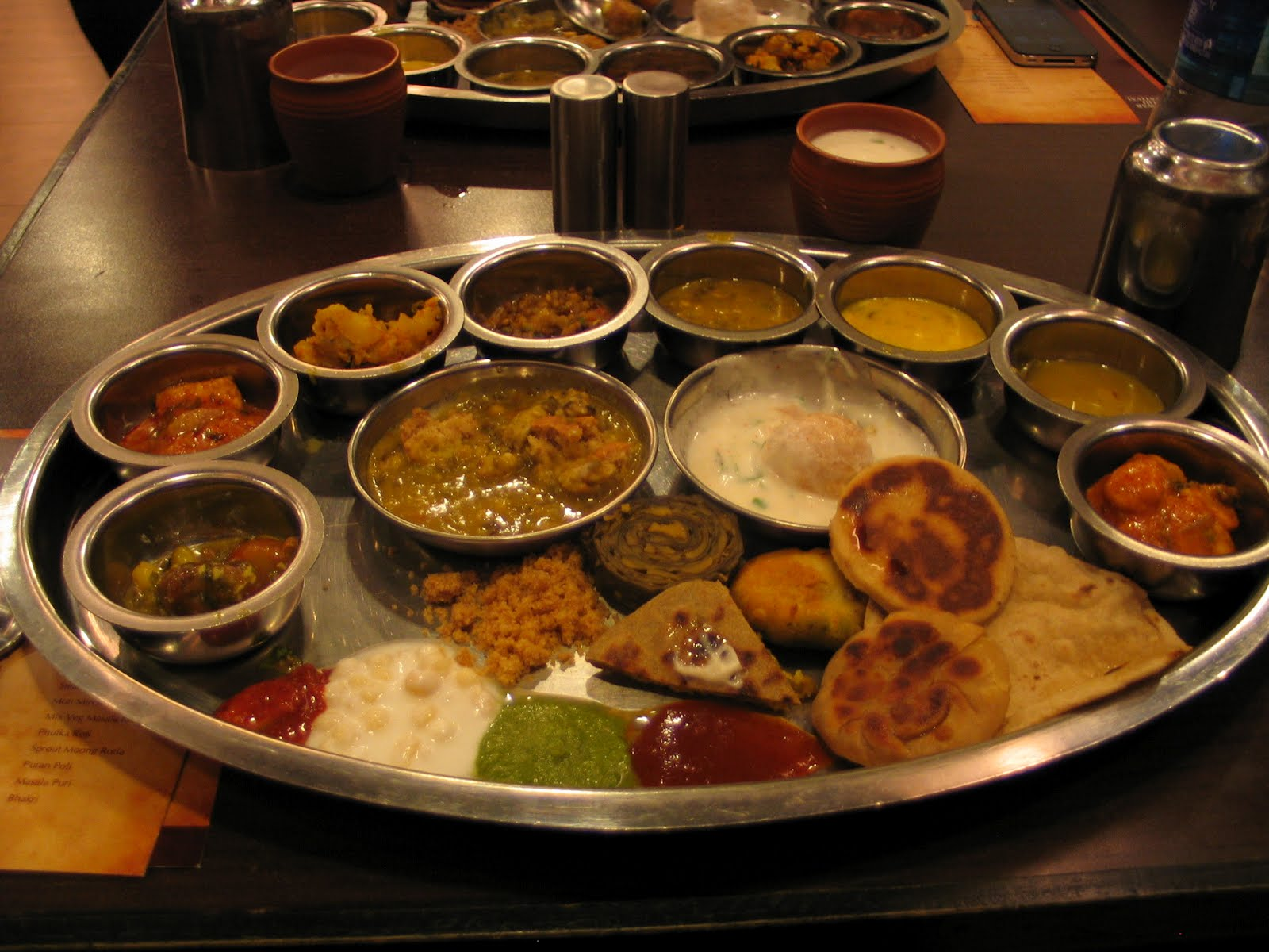 """The famous Rajasthani thali. Courtesy:   https://www.scoopwhoop.com/inothernews/indian-thalis/#.hkkg6lqzt                        Normal   0           false   false   false     EN-IN   X-NONE   X-NONE                                                                                                                                                                                                                                                                                                                                                                                                    Normal   0           false   false   false     EN-IN   X-NONE   X-NONE                                                                                                                                                                                                                                                                                                                                                                                 /* Style Definitions */  table.MsoNormalTable {mso-style-name:""""Table Normal""""; mso-tstyle-rowband-size:0; mso-tstyle-colband-size:0; mso-style-noshow:yes; mso-style-priority:99; mso-style-qformat:yes; mso-style-parent:""""""""; mso-padding-alt:0cm 5.4pt 0cm 5.4pt; mso-para-margin-top:0cm; mso-para-margin-right:0cm; mso-para-margin-bottom:10.0pt; mso-para-margin-left:0cm; line-height:115%; mso-pagination:widow-orphan; font-size:11.0pt; font-family:""""Calibri"""",""""sans-serif""""; mso-ascii-font-family:Calibri; mso-ascii-theme-font:minor-latin; mso-fareast-font-family:""""Times New Roman""""; mso-fareast-theme-font:minor-fareast; mso-hansi-font-family:Calibri; mso-hansi-theme-font:minor-latin;}"""