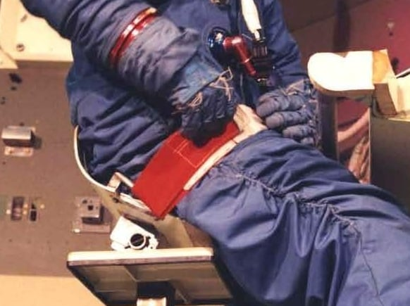 Engineer in space suit demonstrated chair and lap belt in MOL mockup ( NRO MOL photo 9 . Credit: McDonnell-Douglas and NRO).