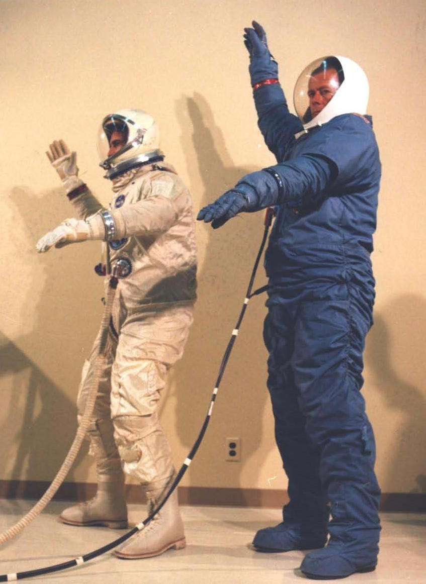 Side-by-side comparison of the David Clark Co. G4C Gemini suit and the Hamilton Standard MH-5 MOL suit in its blue training version. ( NRO photo 18 , credit: McDonnell-Douglas and NRO.)