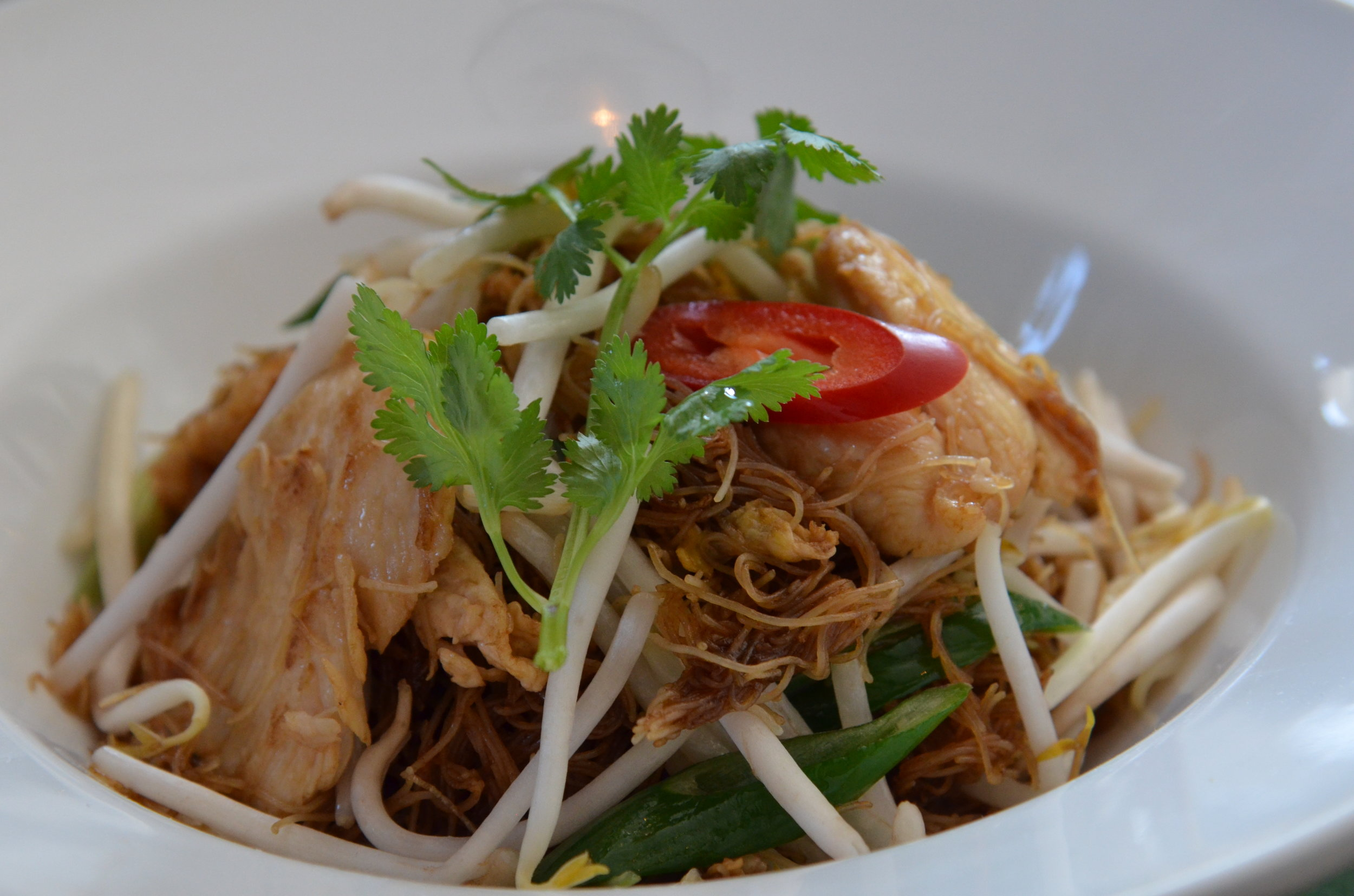 Pad Thungtaak  - Wok fried rice vermicelli with chicken,  pork or beancurd, egg, dark soy sauce and beansprouts